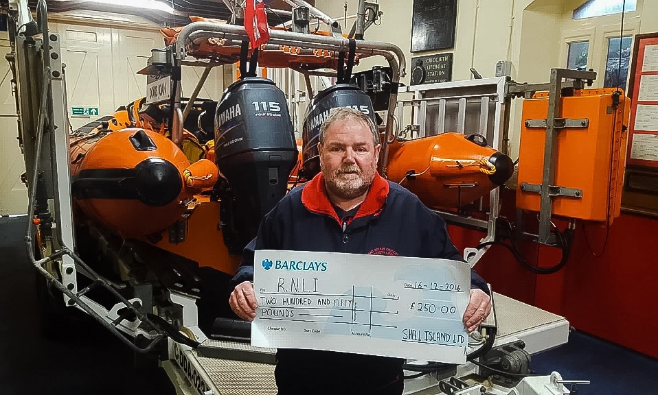 Peter Williams, Criccieth Lifeboat Operations Manager with the cheque