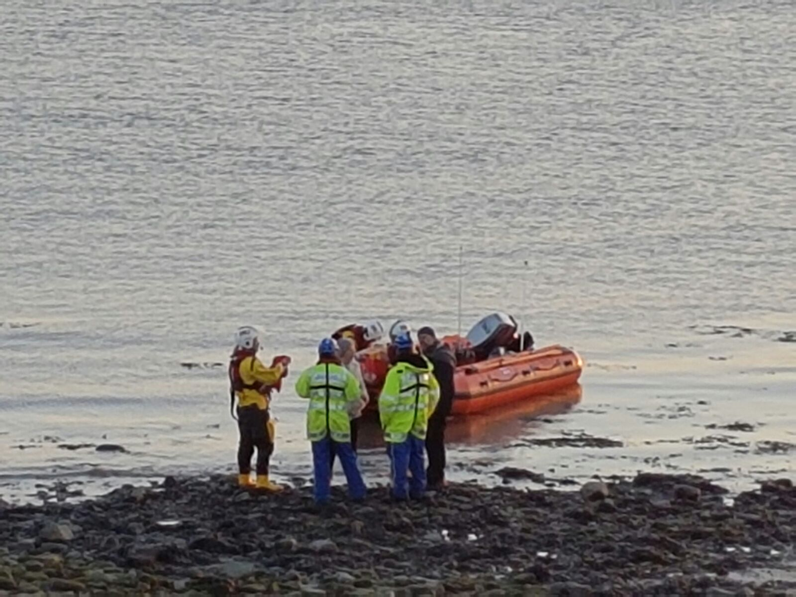 People being brought to shore