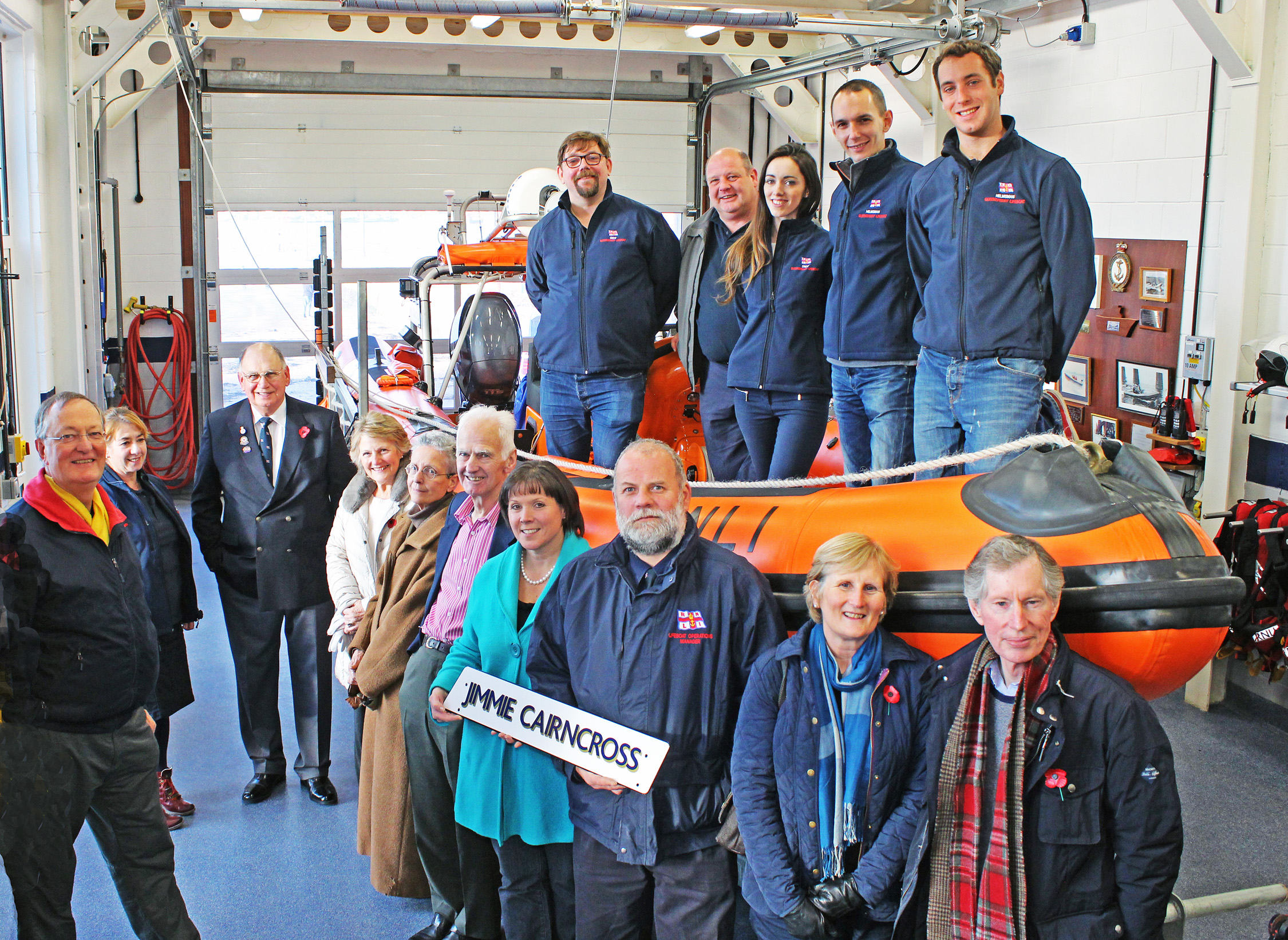 Representatives of RNLI Queensferry Lifeboat Station, along with Trustees from the Jimmie Cairncross Charitable Trust in the boatshed at Queensferry Lifeboat Station. Pictured with Atlantic 85 Jimmie Cairncross inshore lifeboat.