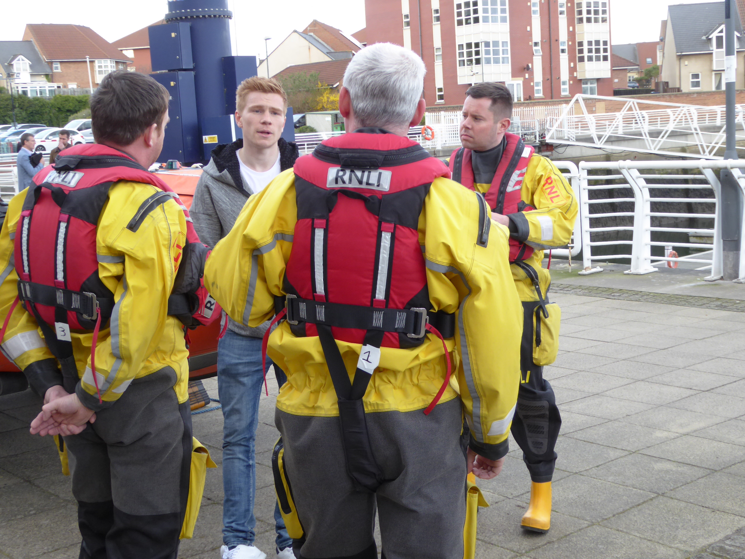 Duncan Watmore talking to Sunderland RNLI volunteers (Mark Cleminson, Andrew McGill, and Paul Nicholson) during his visit