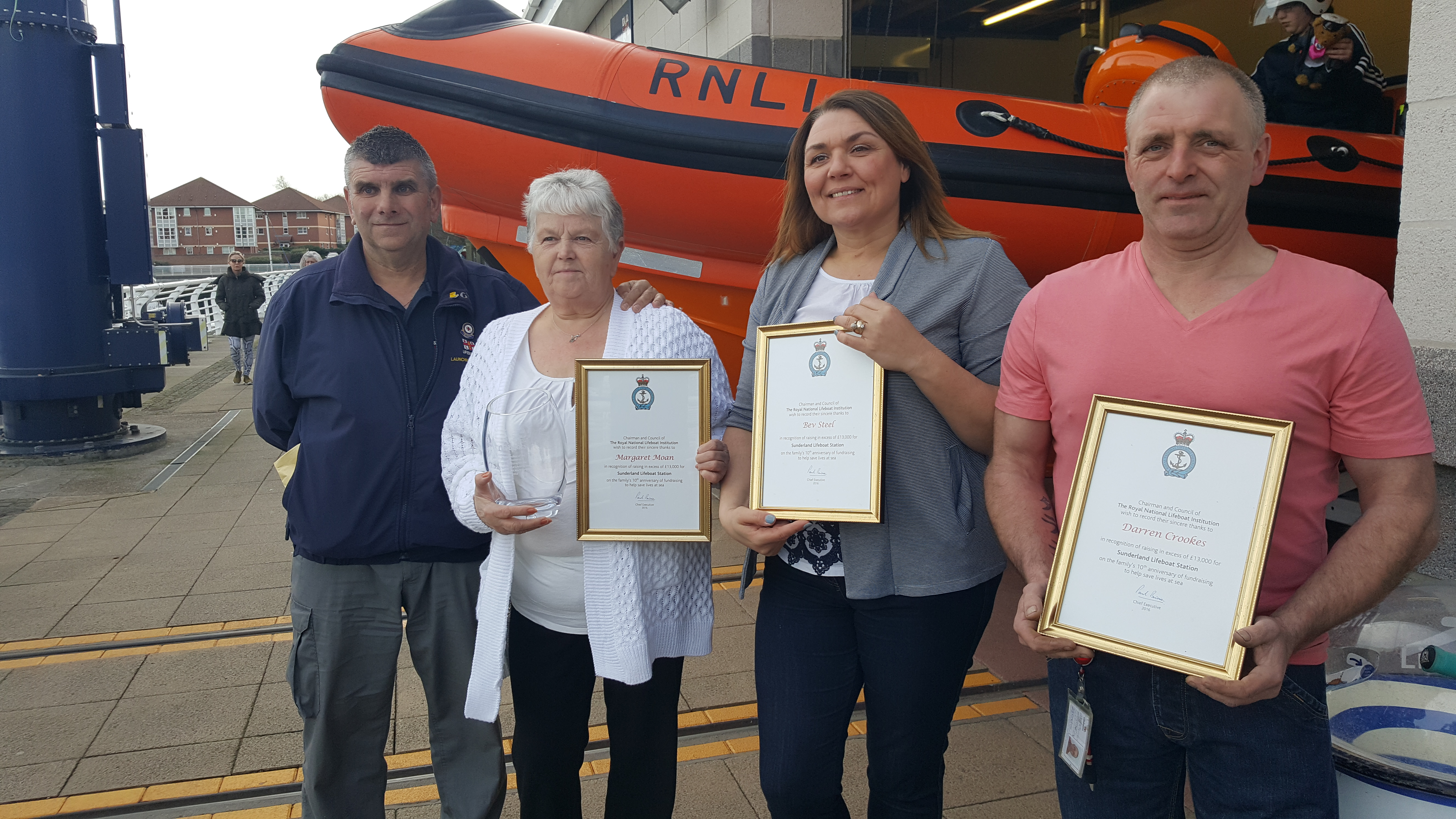 Sunderland RNLI Operations Manager with fundraisers Margaret Moan, Bev Steel, and Darren Crookes