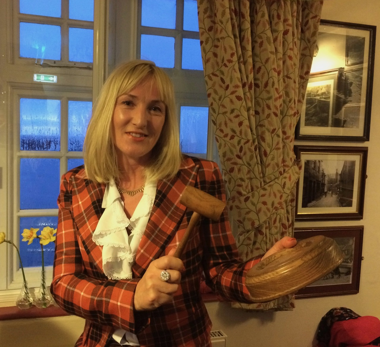 BBC TV Flog It presenter Caroline Hawley wielding the hammer at Staithes and Runswick RNLI's annual charity auction