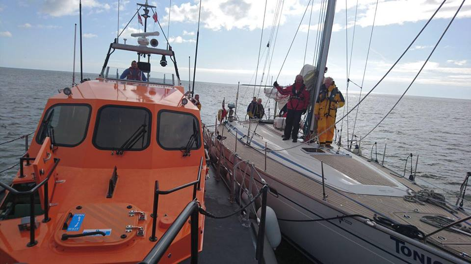 Shannon Class lifeboat alsongside Yacht Tonic