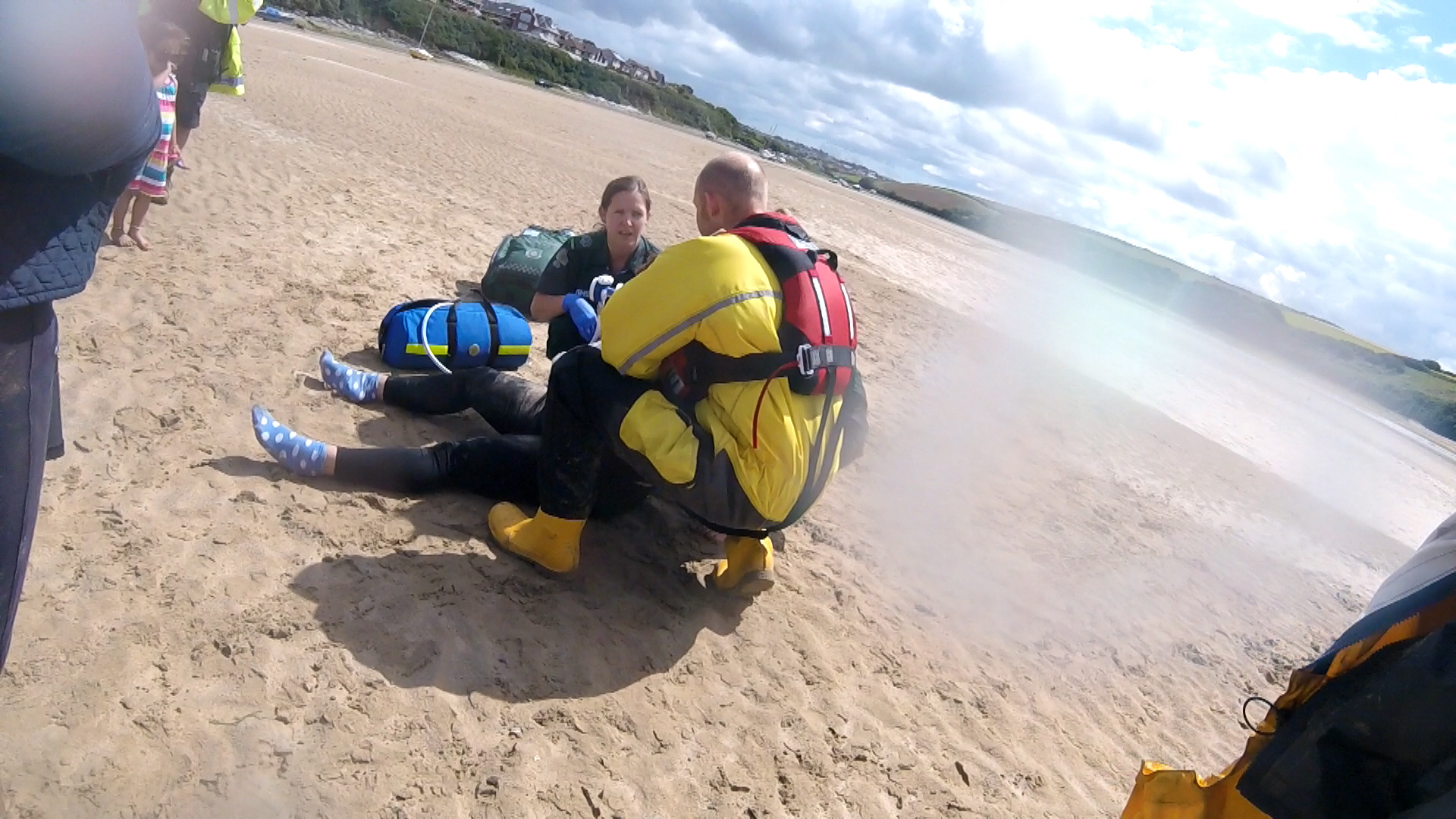 Lifeboat volunteer assists paramedic treating injured horse-rider