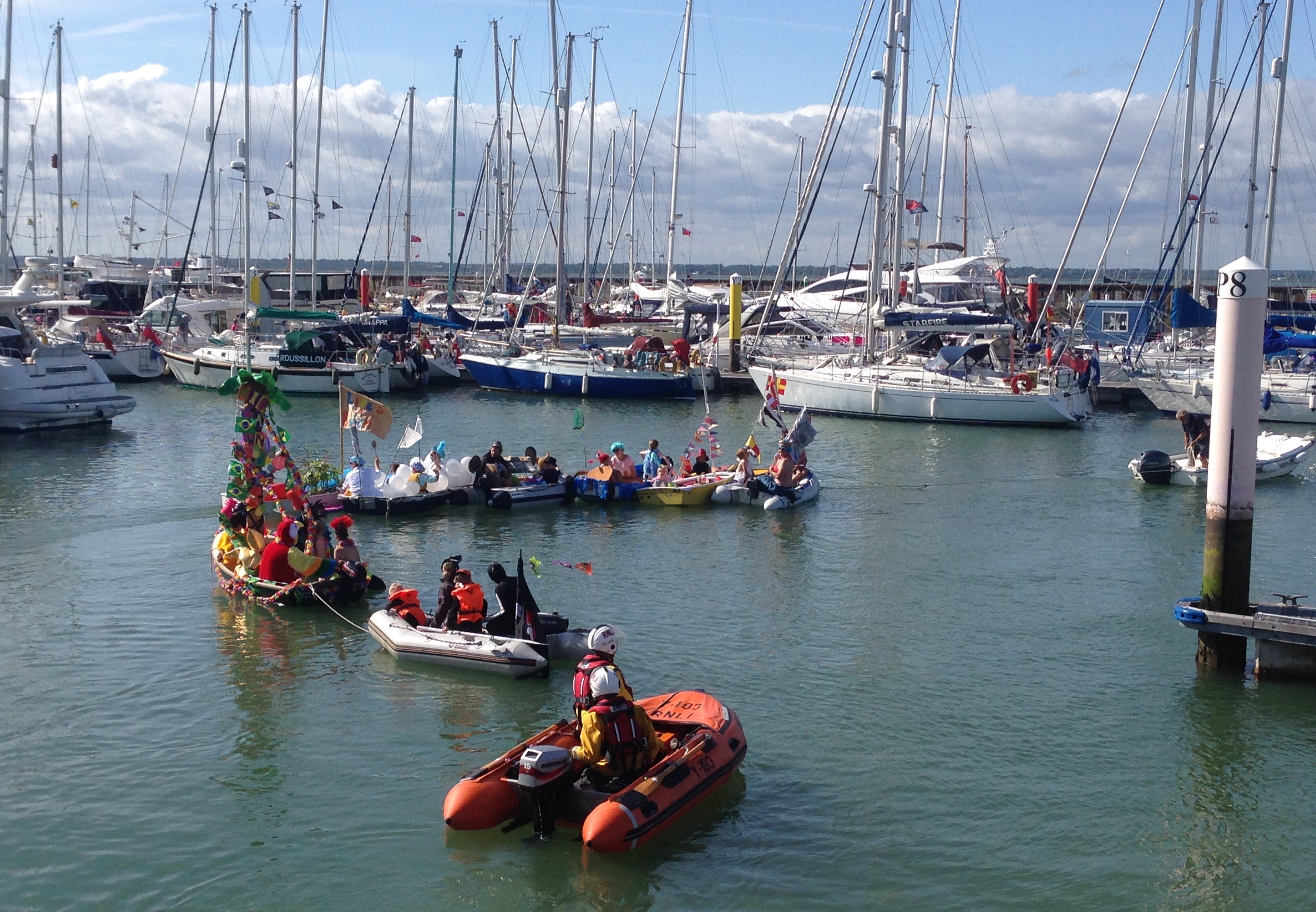 Yarmouth RNLI Y-boat acting as safety boat during Yarmouth Carnival's Decorated Dinghies Competition yesterday afternoon.