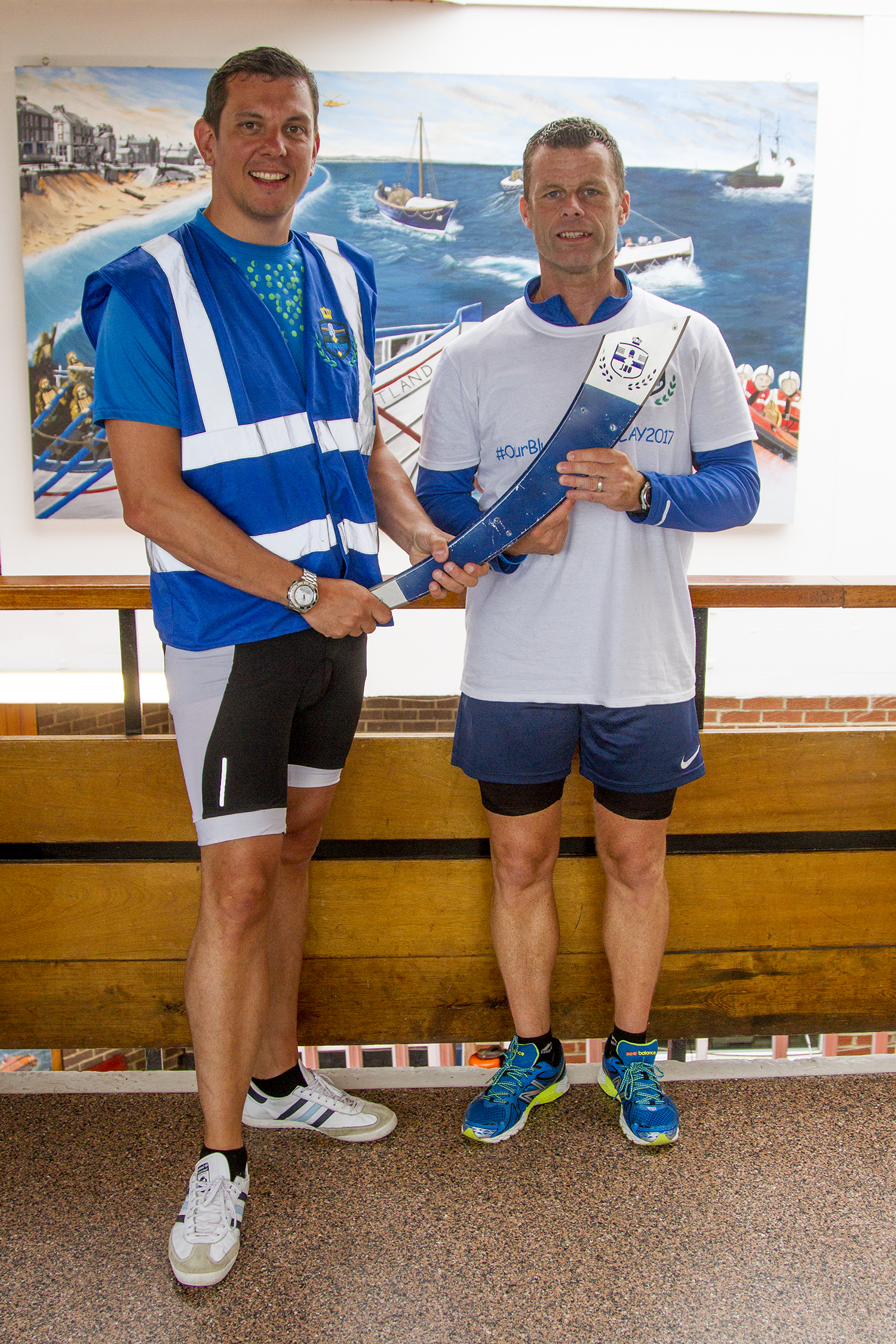 Ian Widdas (left) and Phil Spencer of Cleveland Police at Redcar lifeboat station with the Our Blue Light torch