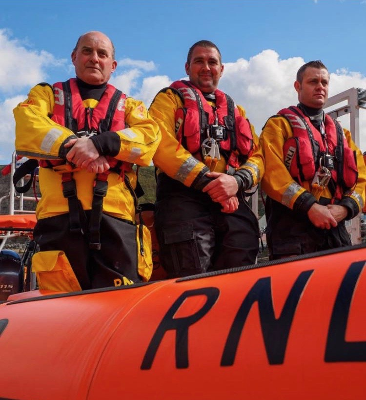 Three crew members on lifeboat