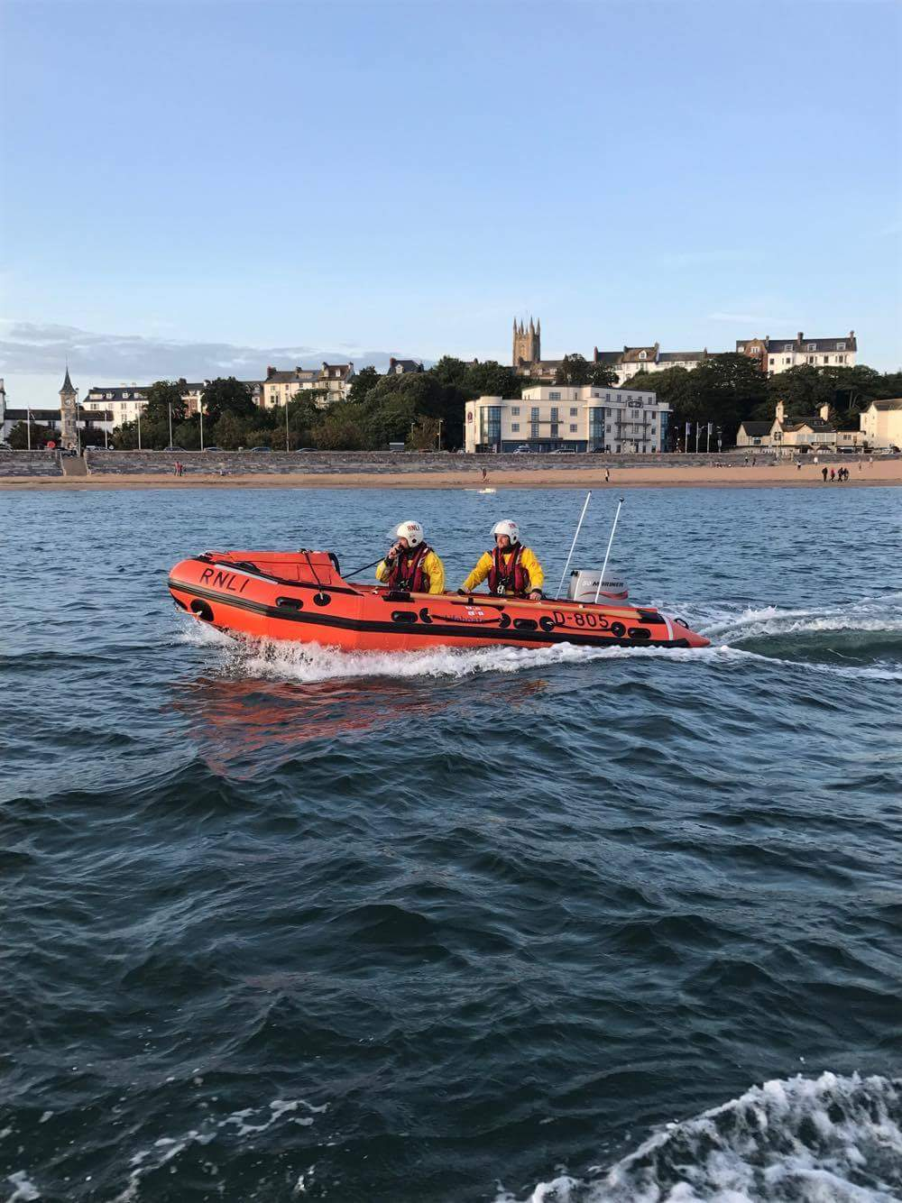 Exmouth Crew volunteers escorting tow to safety