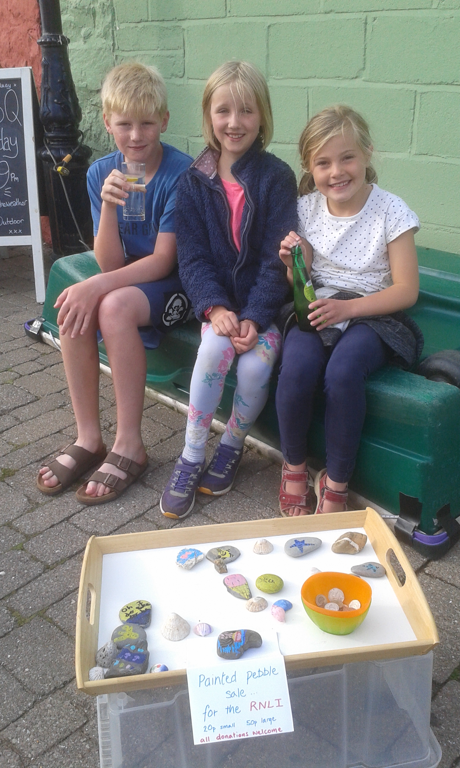 Jemima Leatt and Esther Toward, who live in Wells and Southampton, collected pebbles, hand painted them and set up a small stall on the quay to sell them to passers-by on the quay and raised nearly £30.00