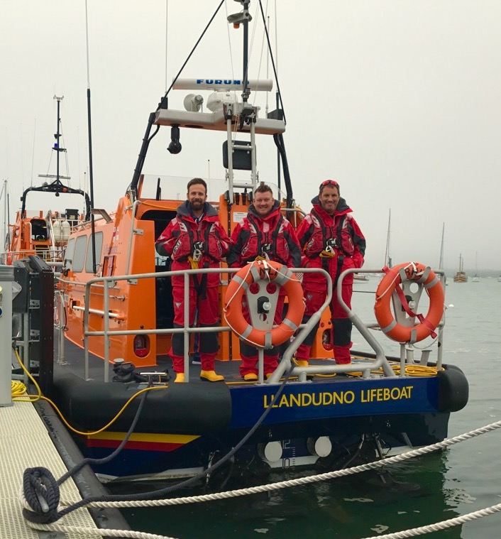 Three of the Llandudno crew aboard the lifeboat after returning to Poole following the rescues.