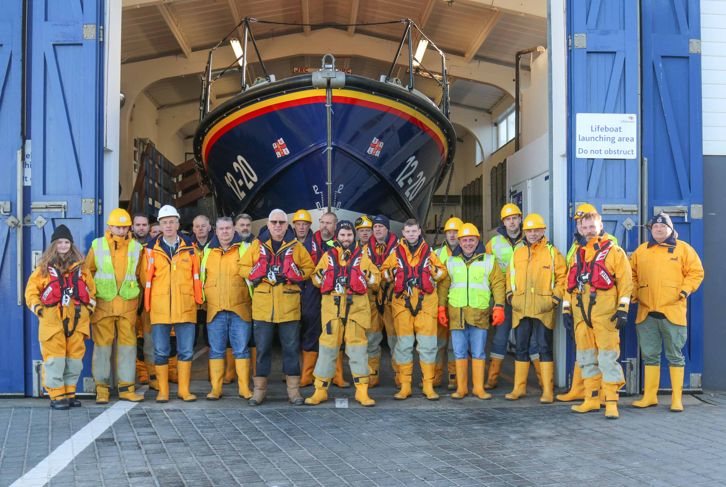 Alex (centre) with the lifeboat crew
