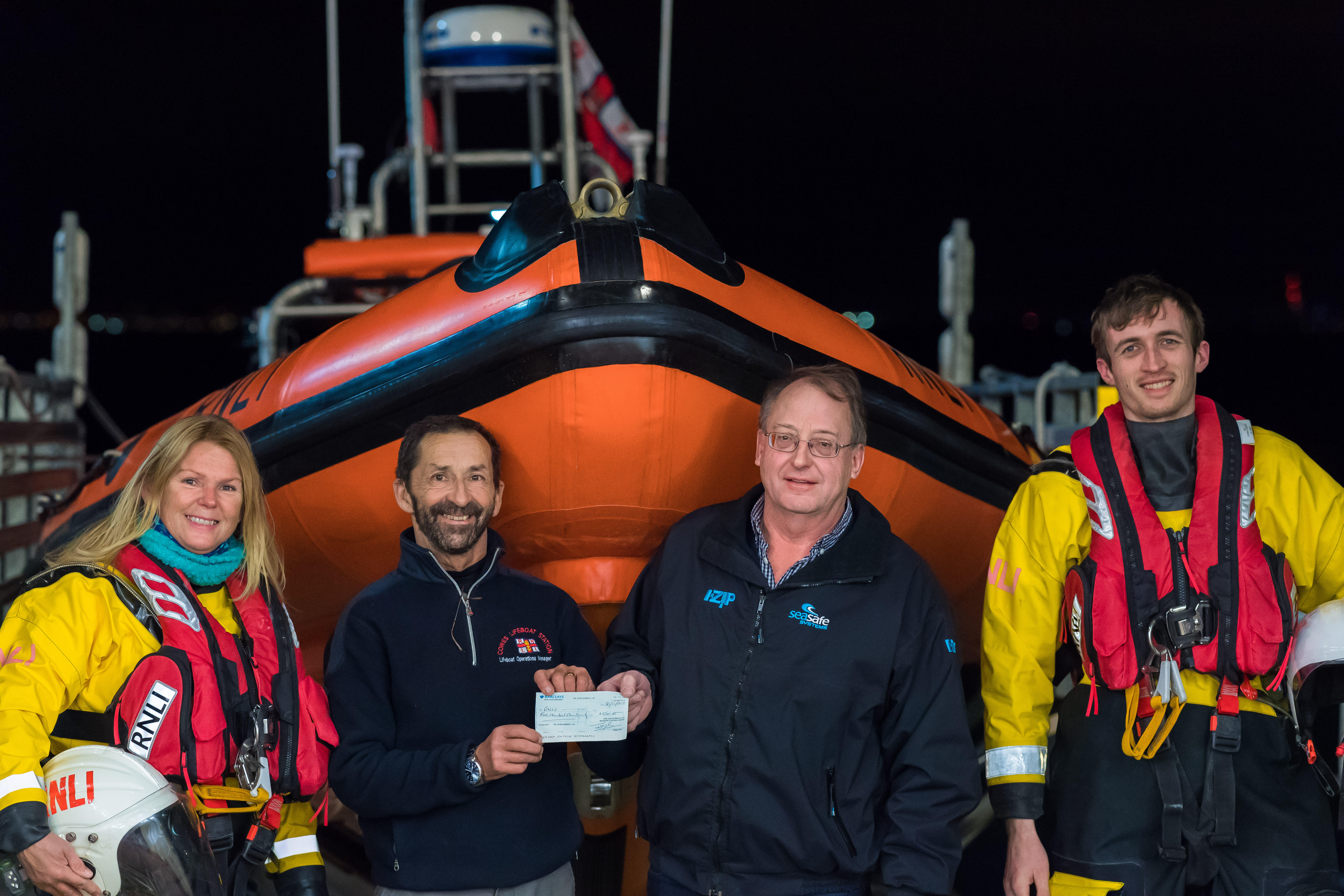 Cheque presentation to Mark from Seasafe managing director Jeremy Dale, with crew members Andrea Vaughan and Myles Hussey also in attendance.