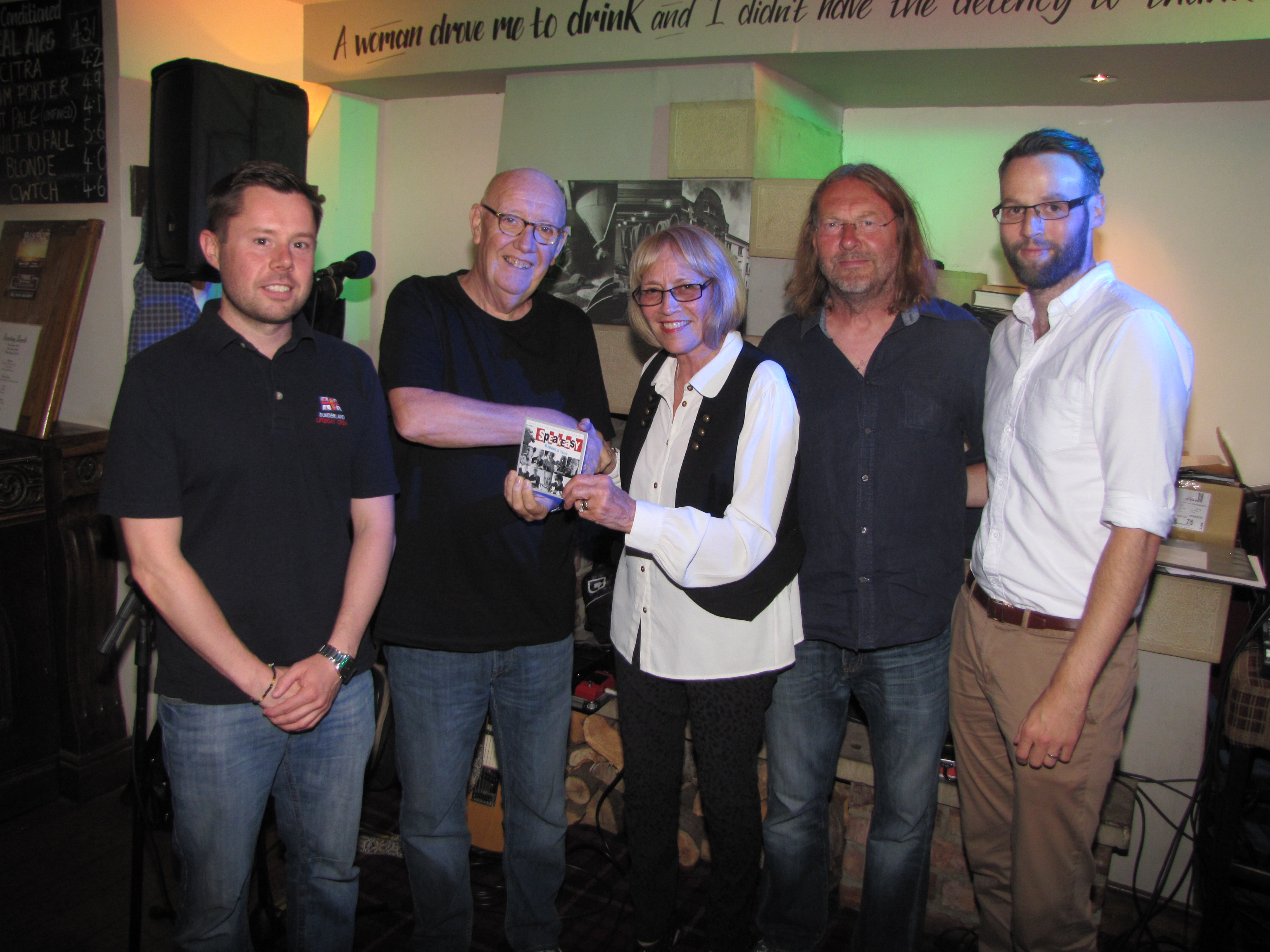 Image of Andrew Cantle's mam and brother with artists from the CD.