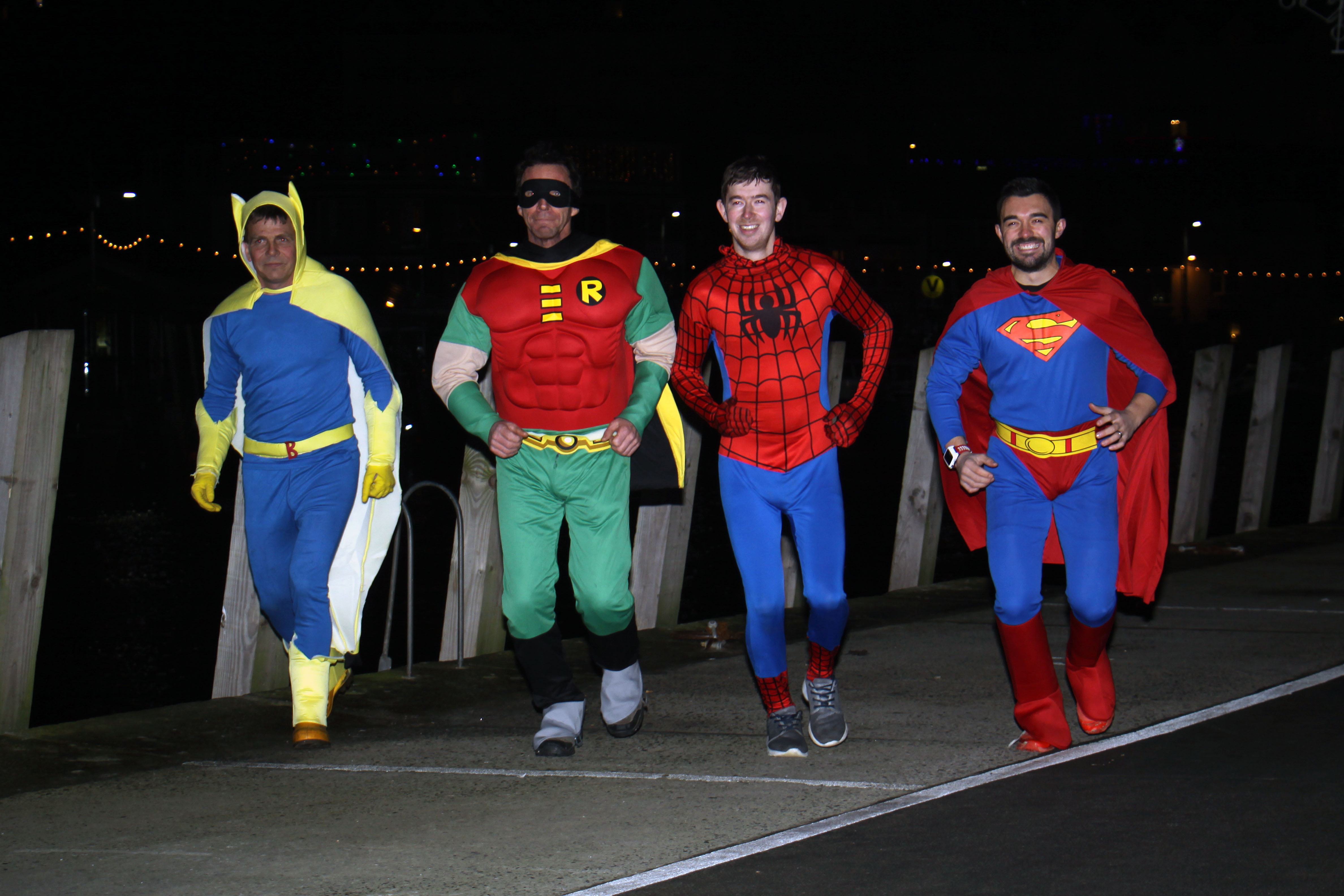 Looe RNLI crew 'superheroes' in their fancy dress, which they were wearing when they responded to a shout on New Year's Day
