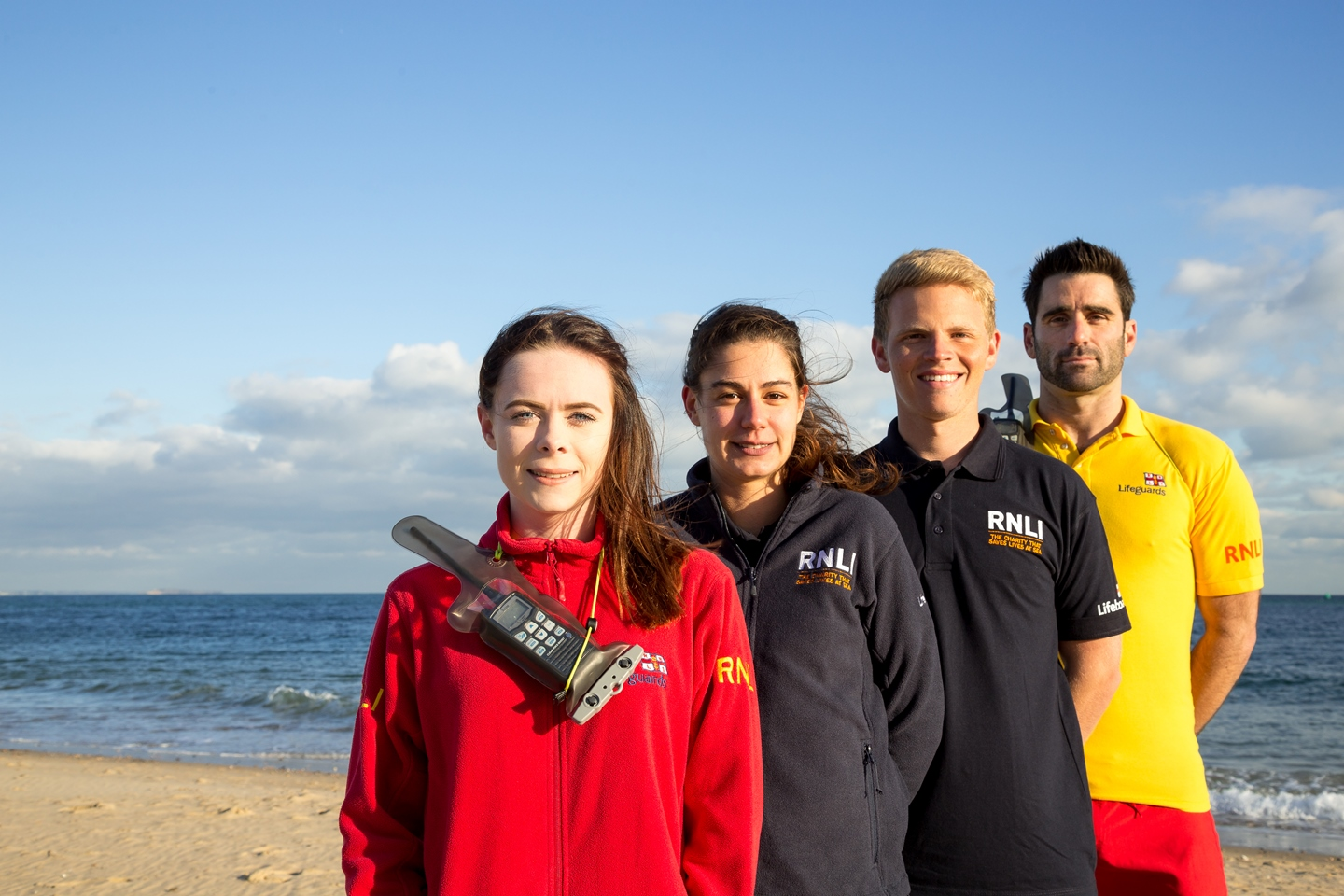 Lifeguards and face to face fundraisers together on the beach