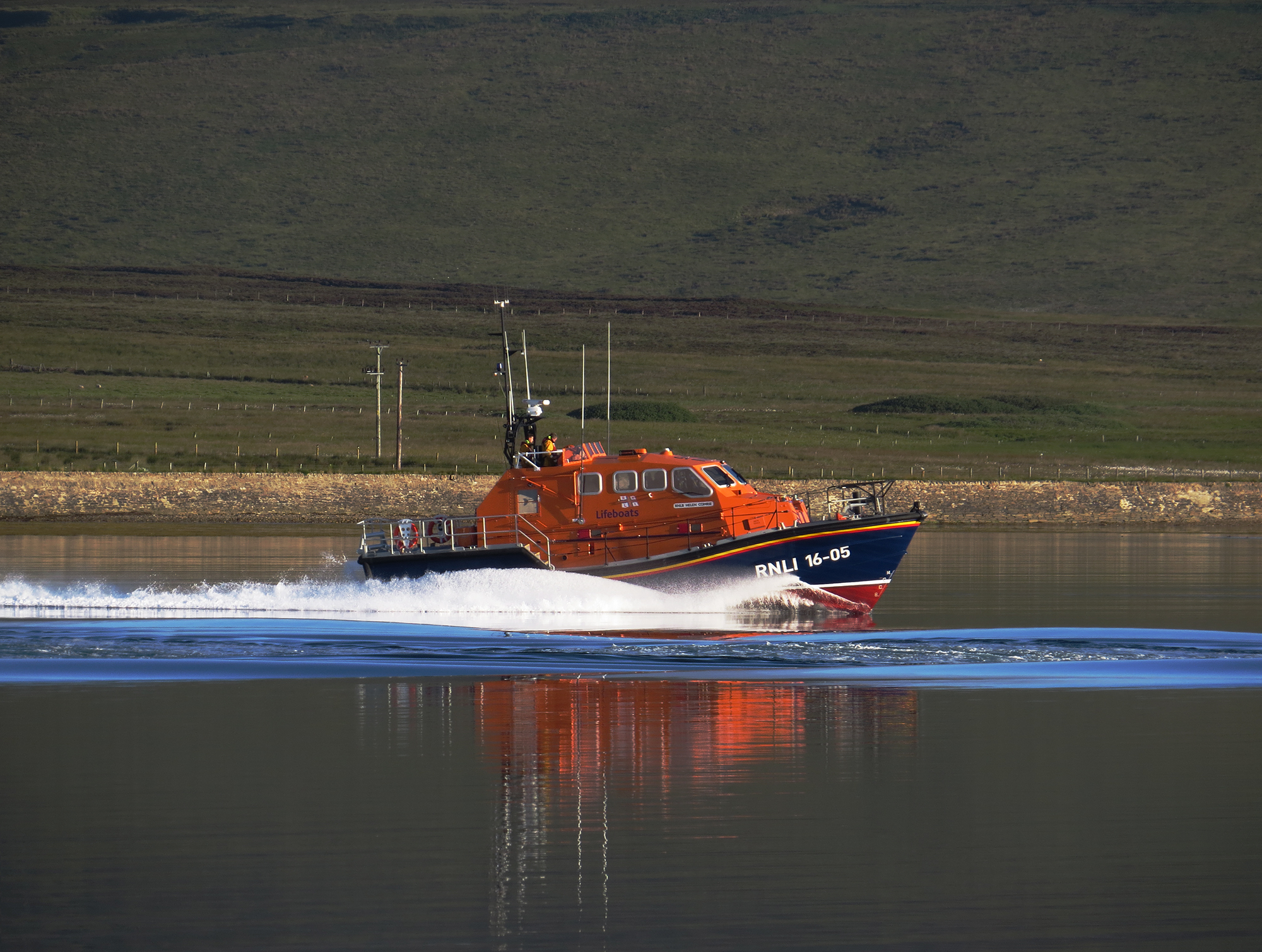 RNLI Longhope Lifeboat launched this morning on service, heading up Longhope Bay.