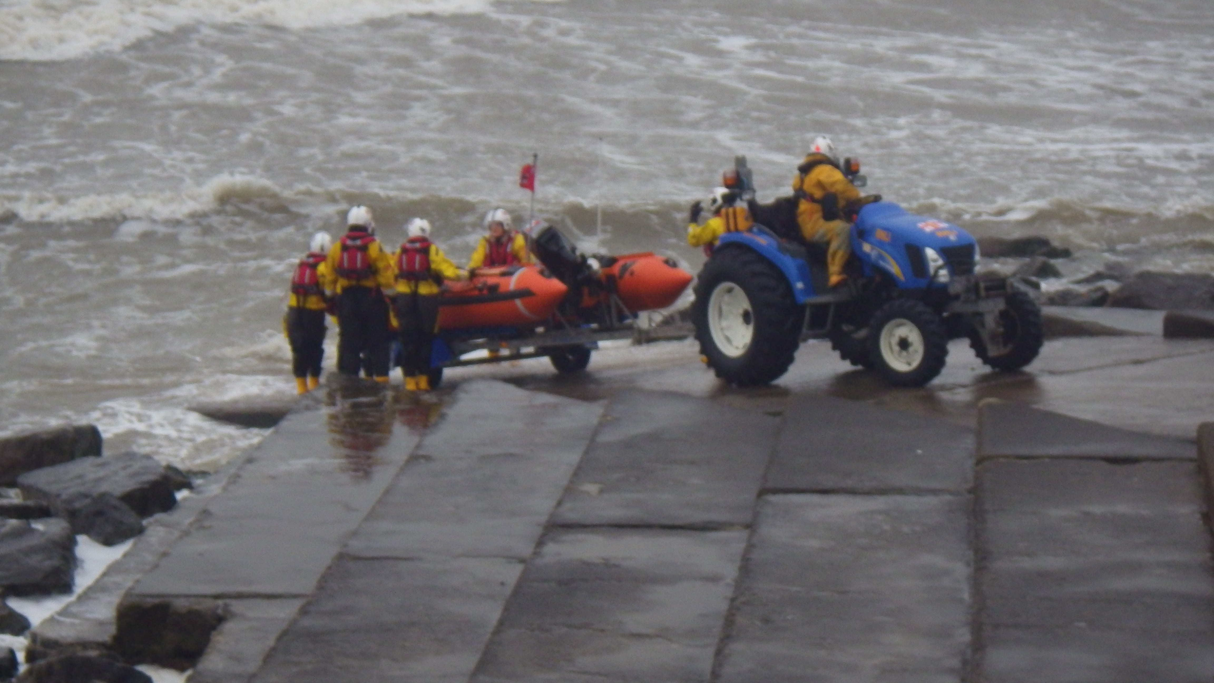 A wind swept sea breaking over the slipway during the launching