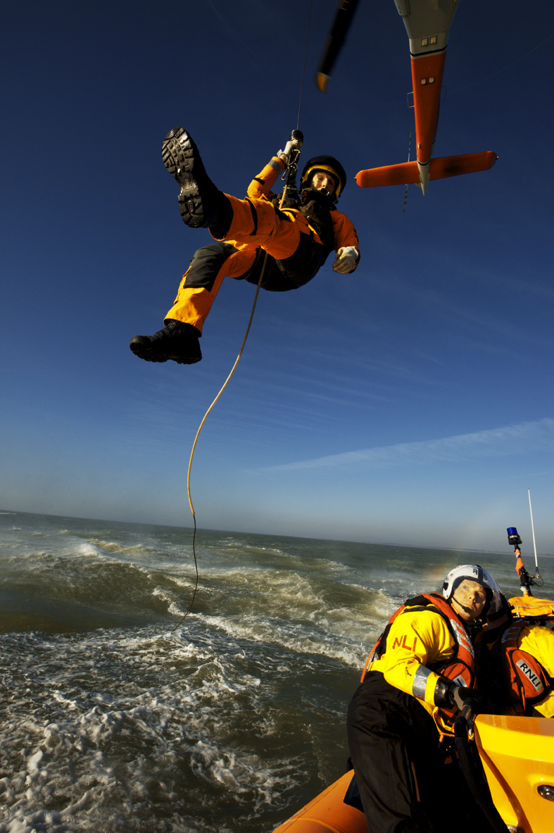 Helicopter crewman being winched onto the lifeboat (library photograph)