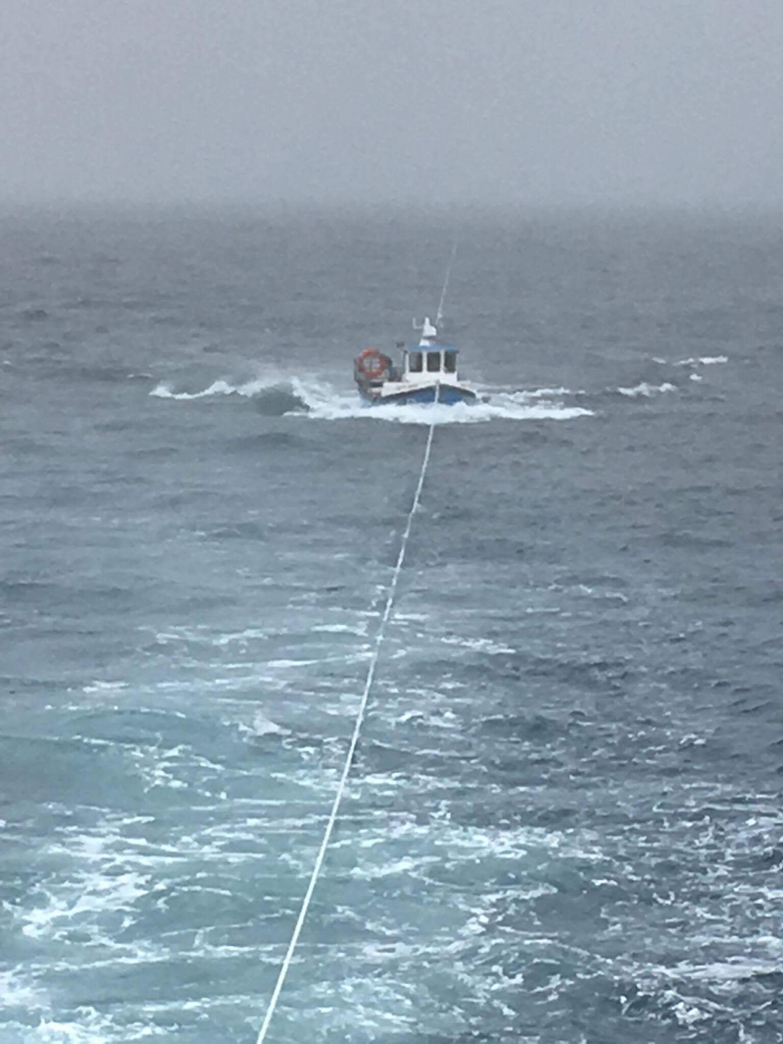 Fishing boat under tow
