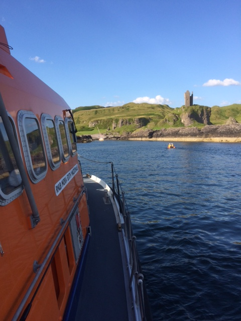 Oban lifeboat and daughter craft assisting the yacht