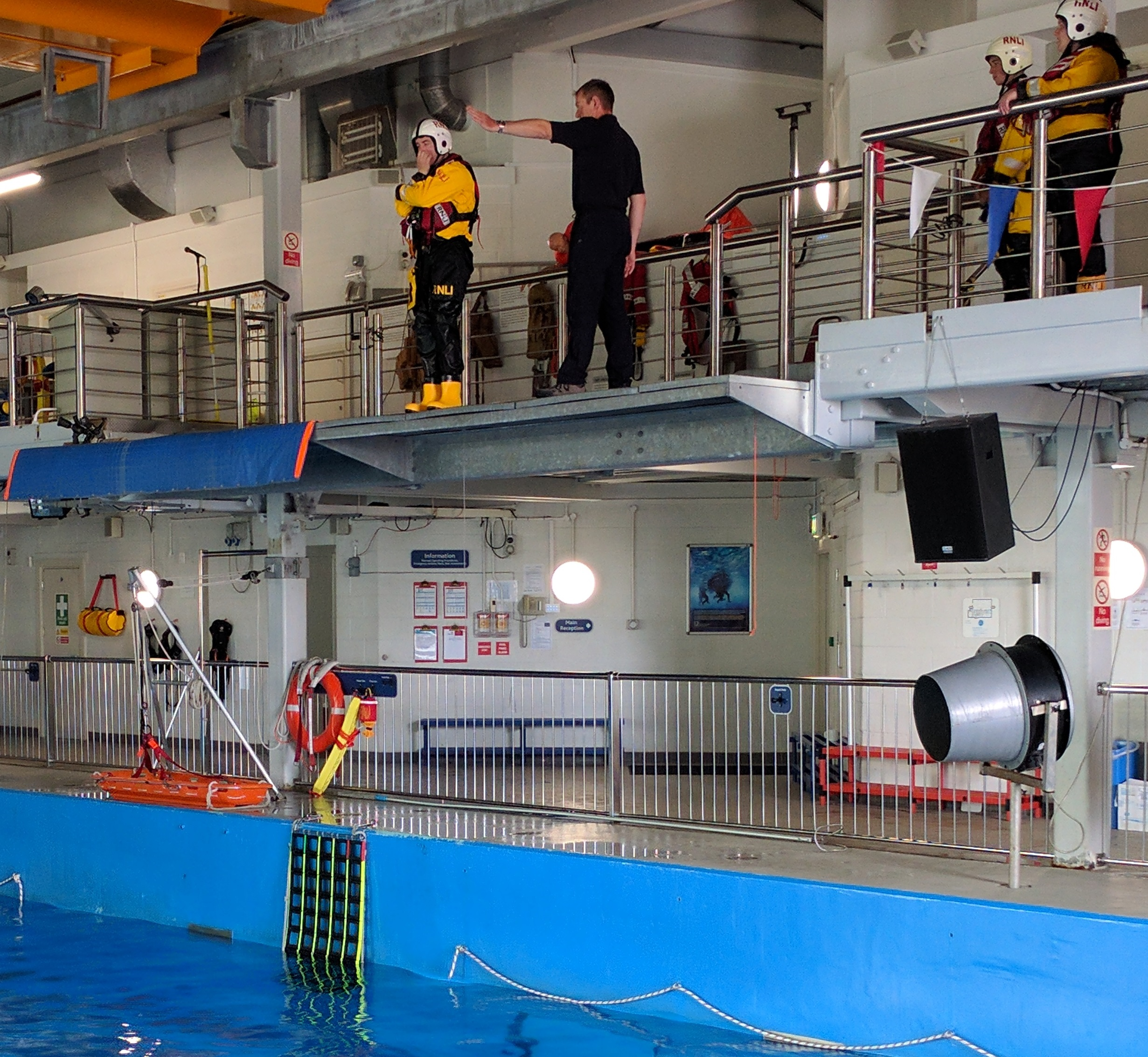 A volunteer learning how to 'abandon ship' with a 4m jump into water