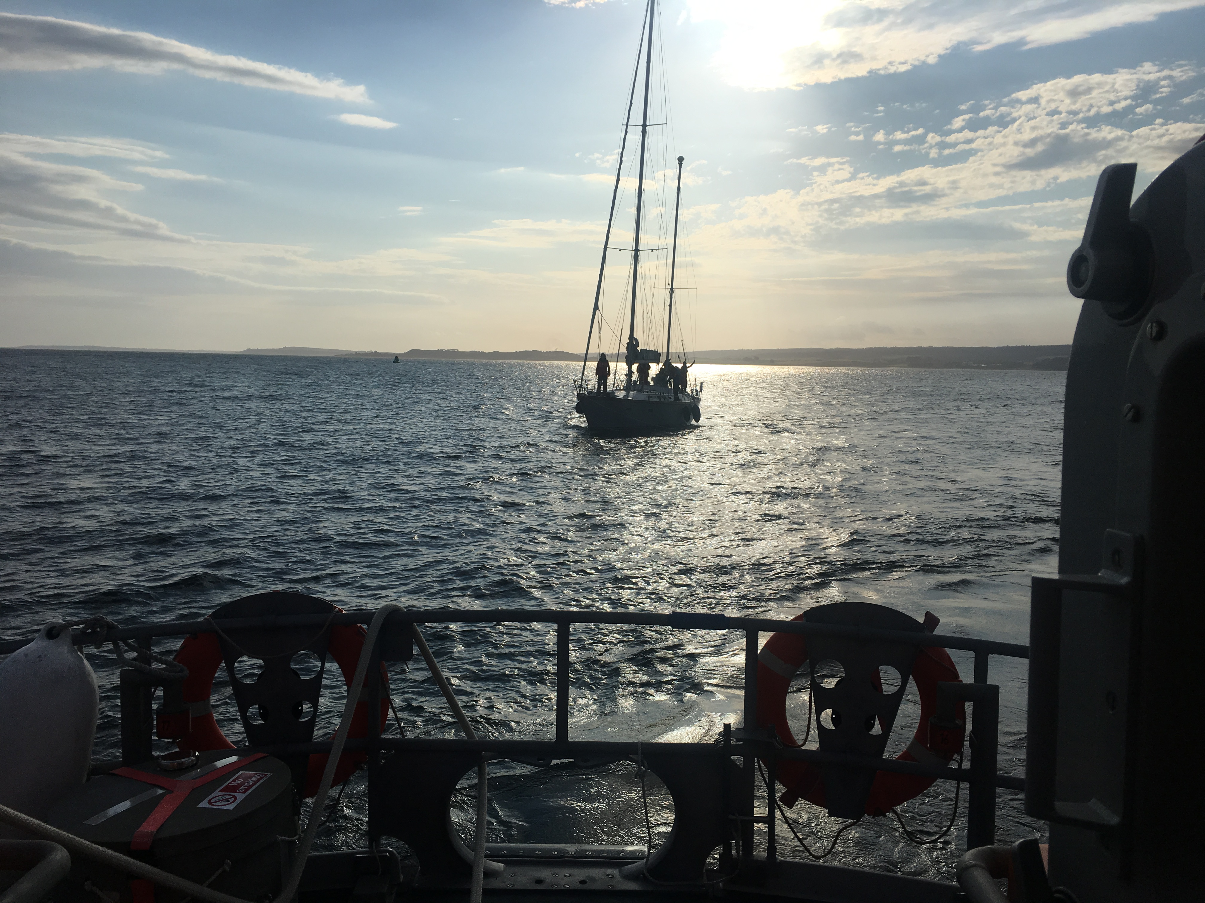 Invergordon Lifeboat with causality vessel under tow