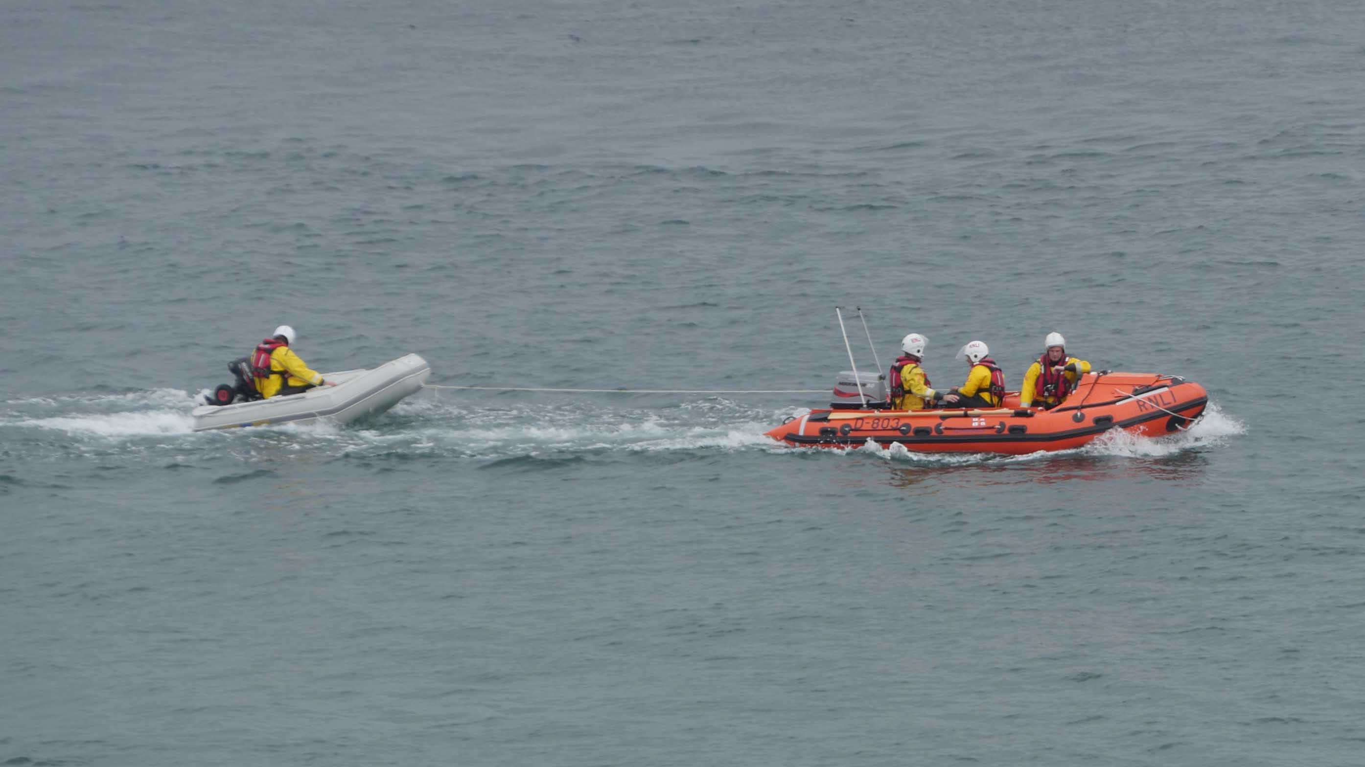 St Ives inshore lifeboat towing the dinghy