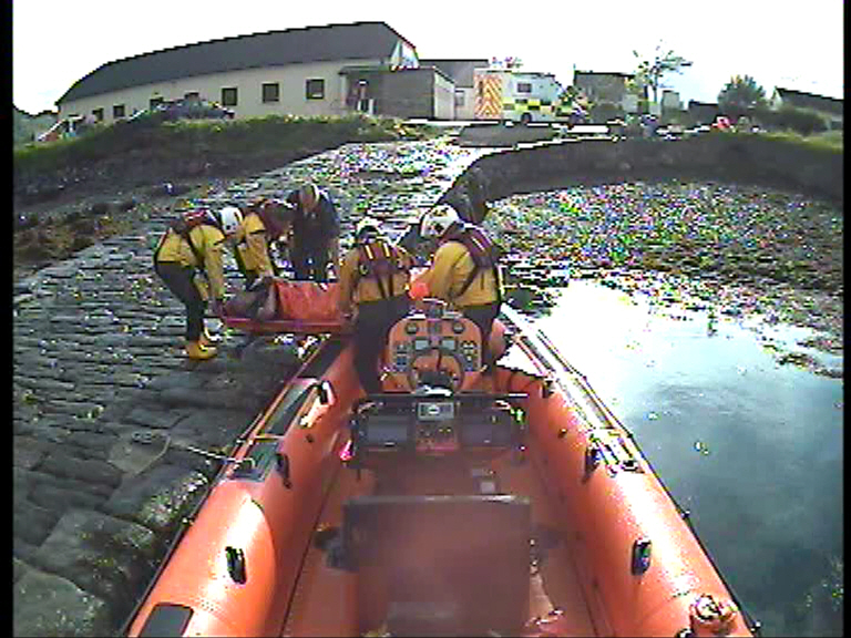 Carrying Casualty with a suspected broken ankle off the lifeboat to the ambulance