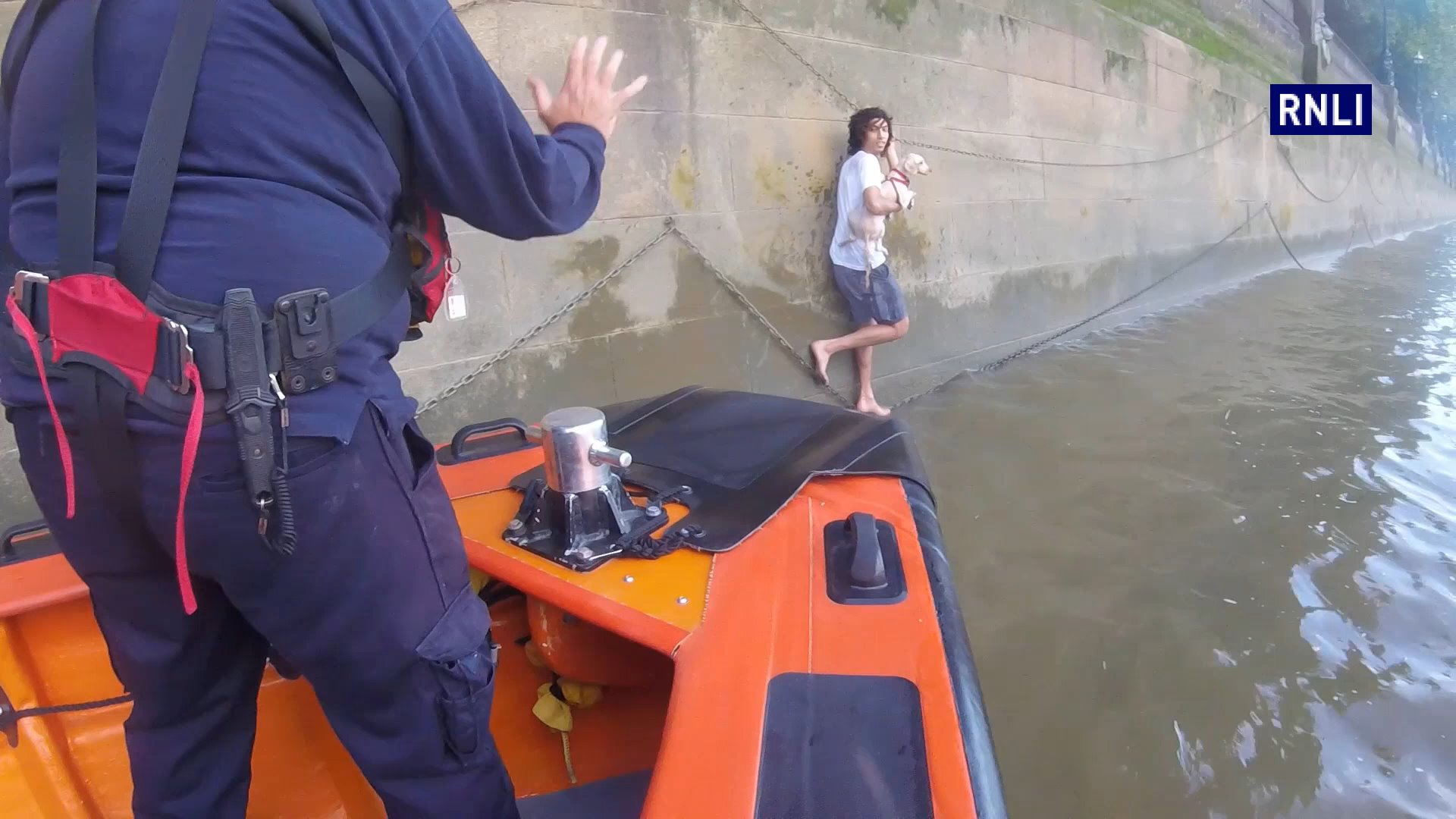 The moment Tower RNLI lifeboat crew rescue the man and the dog