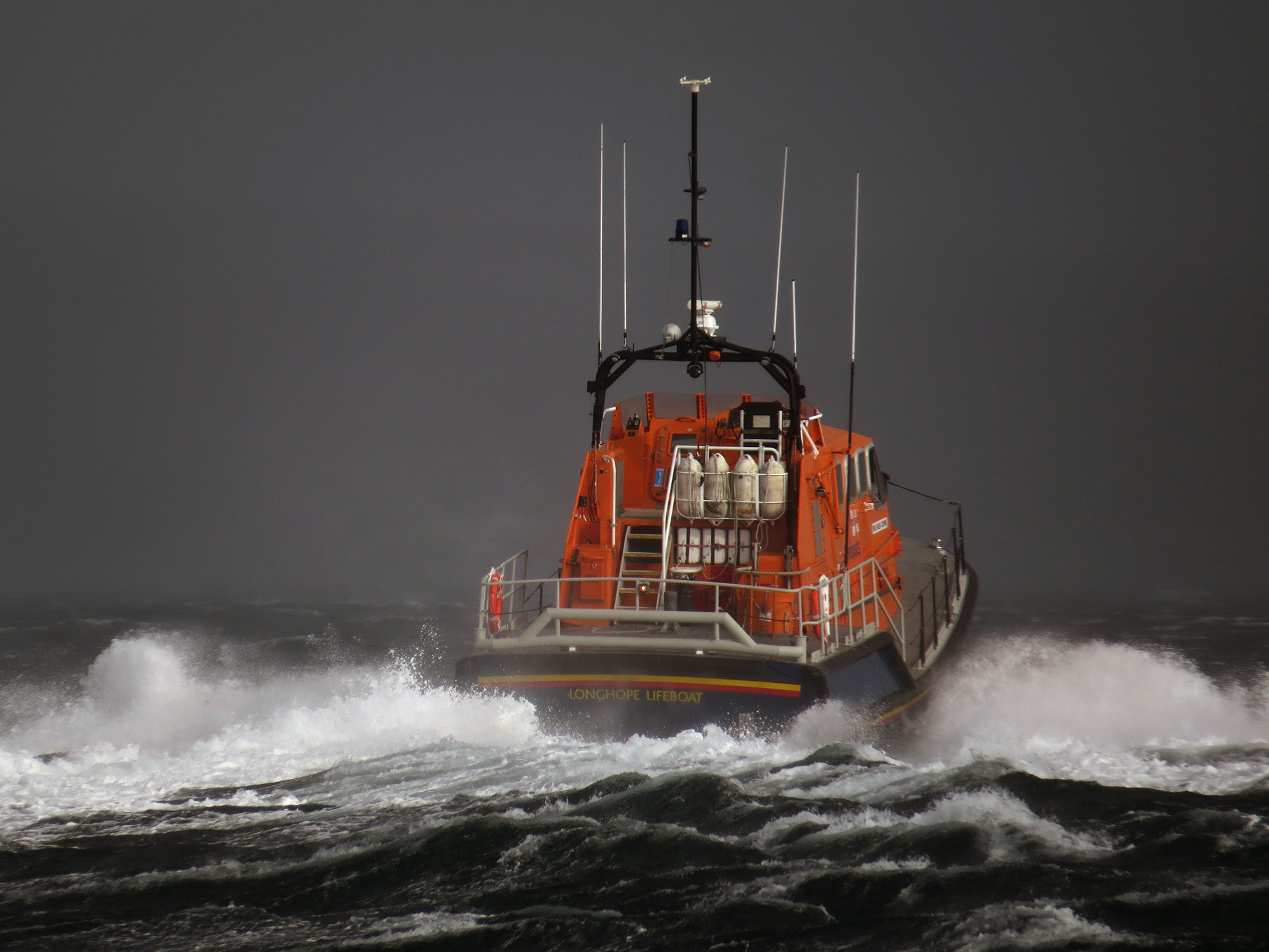 RNLI Longhope Lifeboat leaving station to assist Kirkwall Lifeboat