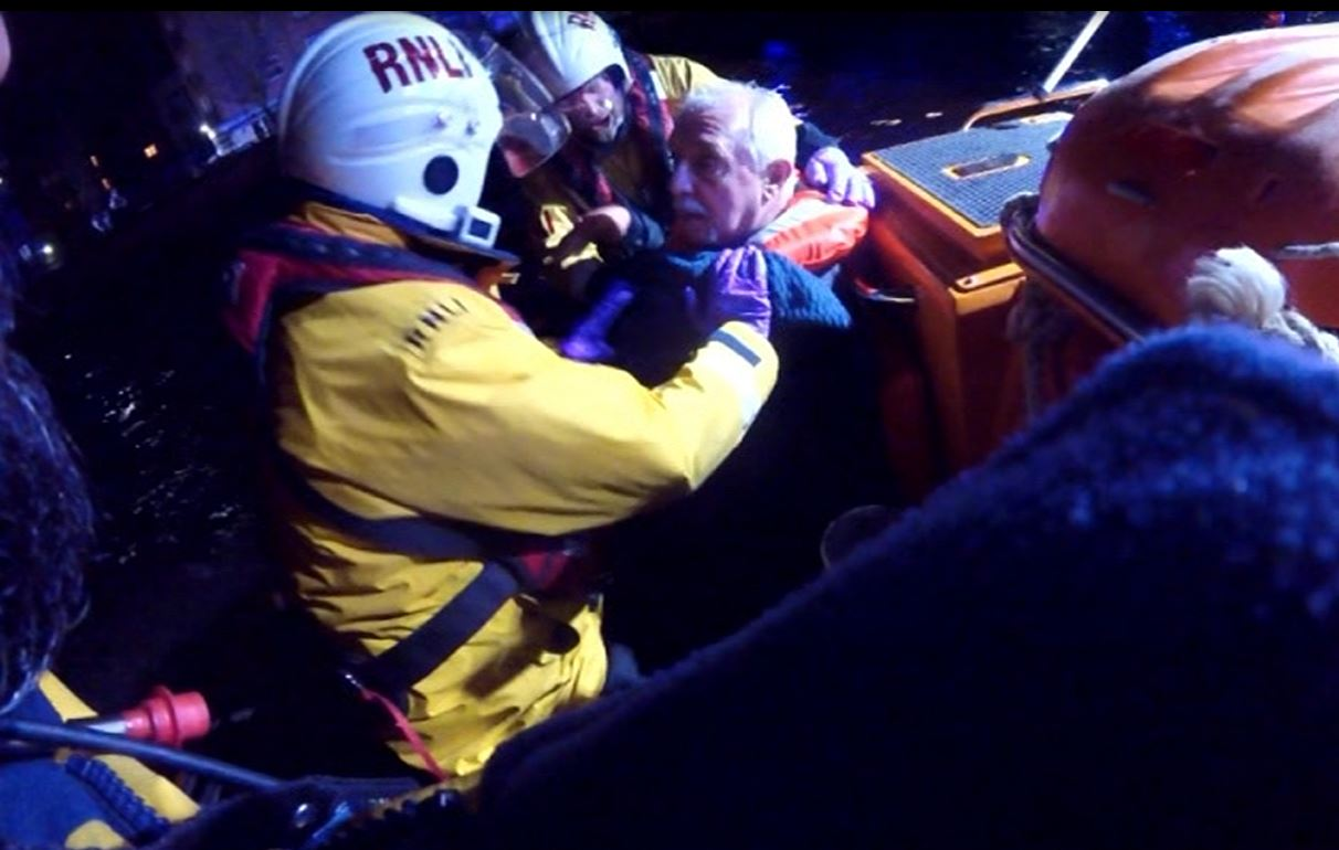 Tower RNLI crew assist the man in the the lifeboat