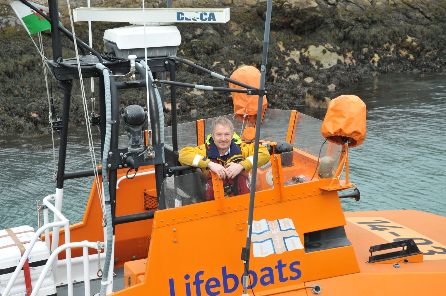 Fishguard RNLI Coxswain Paul Butler has stood down after 24 years of service