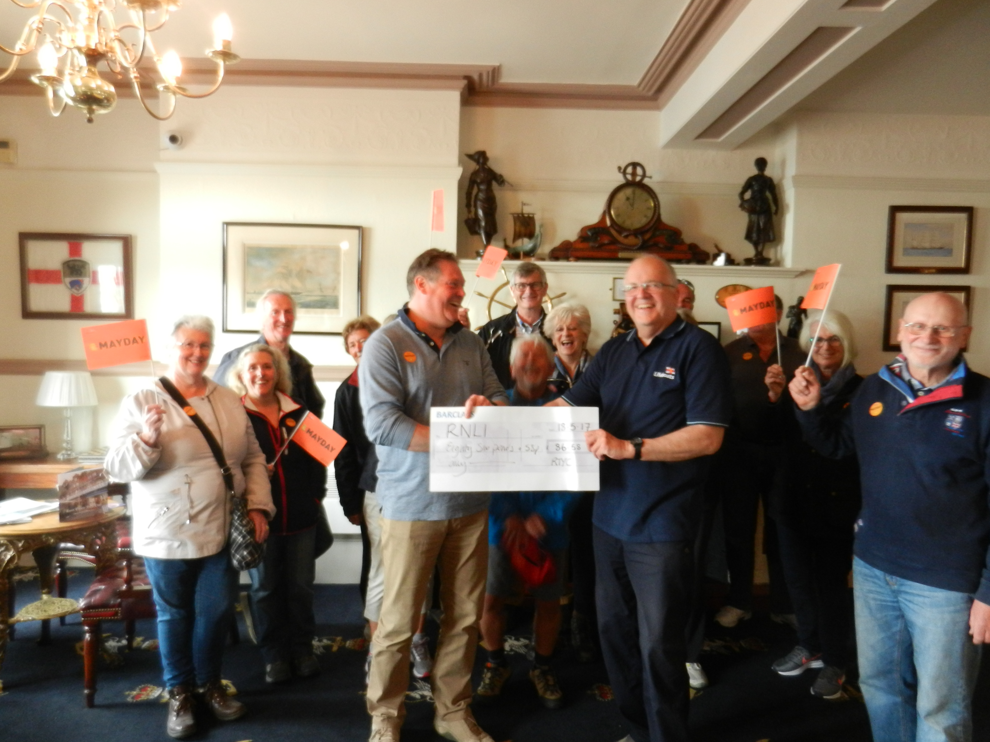 RTYC Commodore handing cheque to Ramsgate LPO