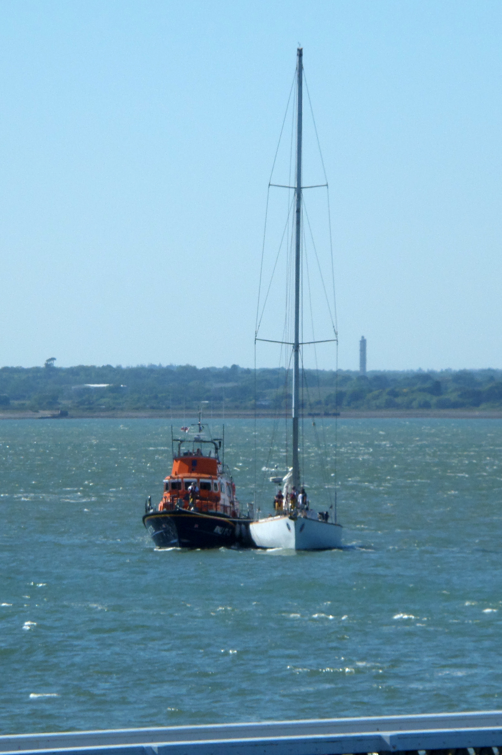 Yacht Great Britain II under tow by the RNLI Yarmouth lifeboat