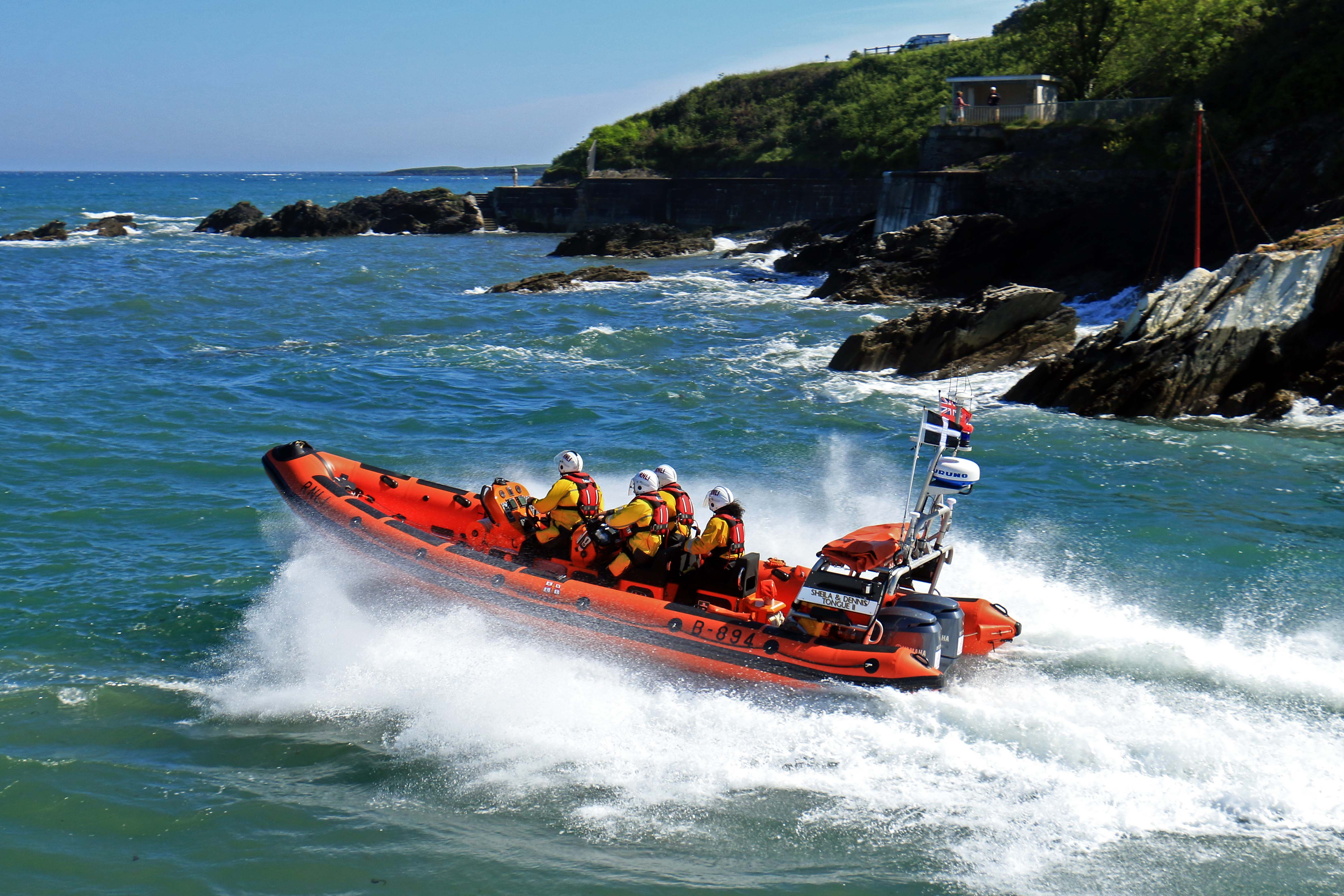 Looe RNLI Atlantic 85 Sheila and Dennis Tongue II leaving Looe and heading towards Polperro