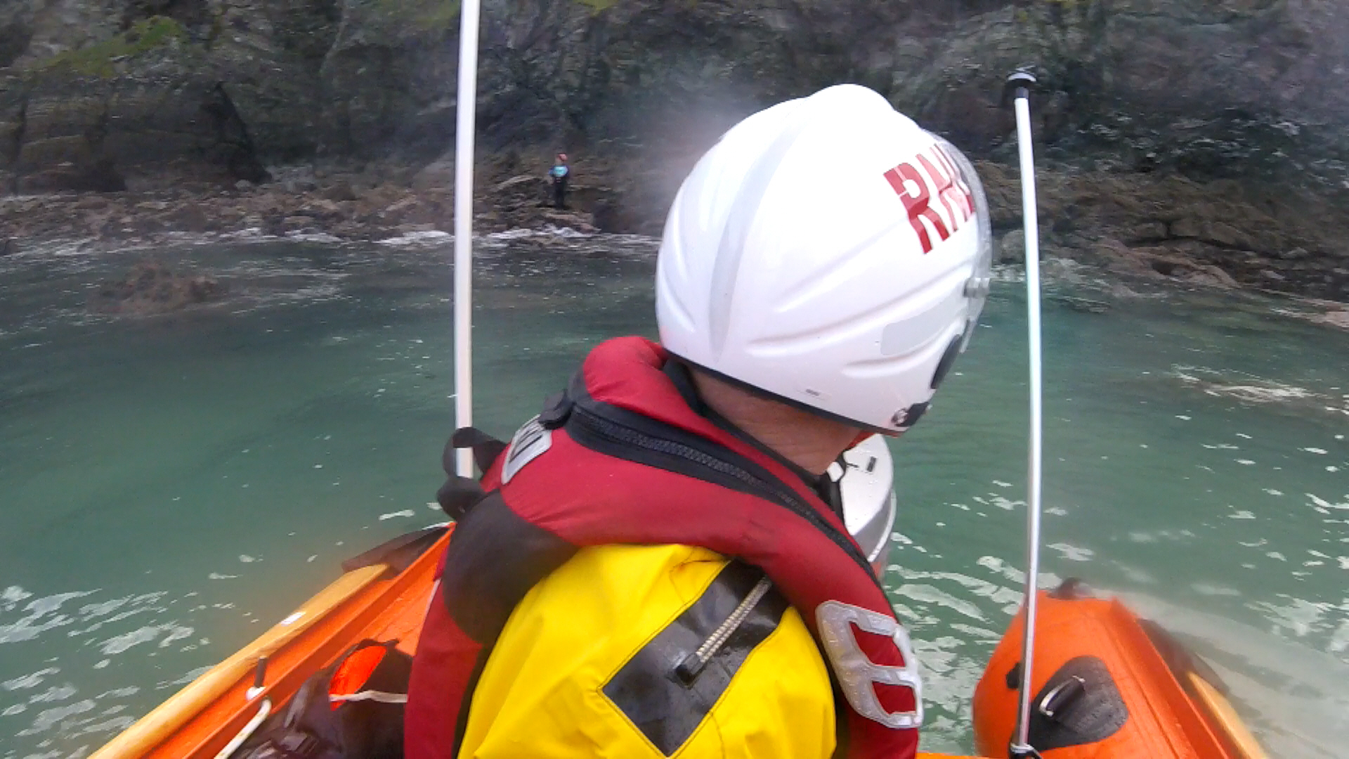 Newquay lifeboat approaches woman trapped by tide below steep cliffs