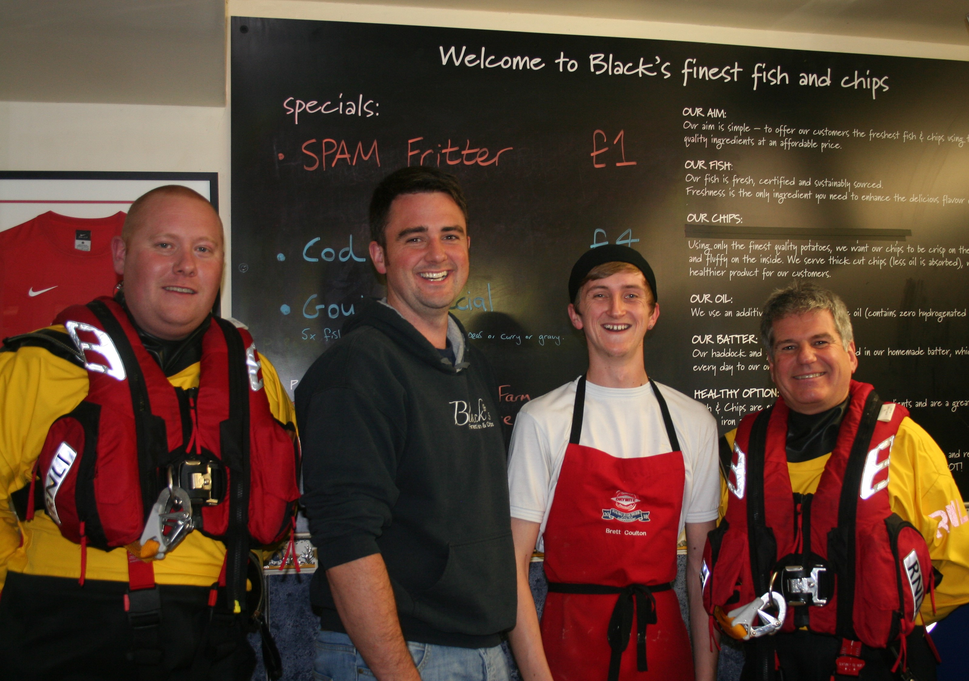 Morecambe lifeboat crew members James Donnell and Steve Wilson with Matthew Black and Brett Coulton