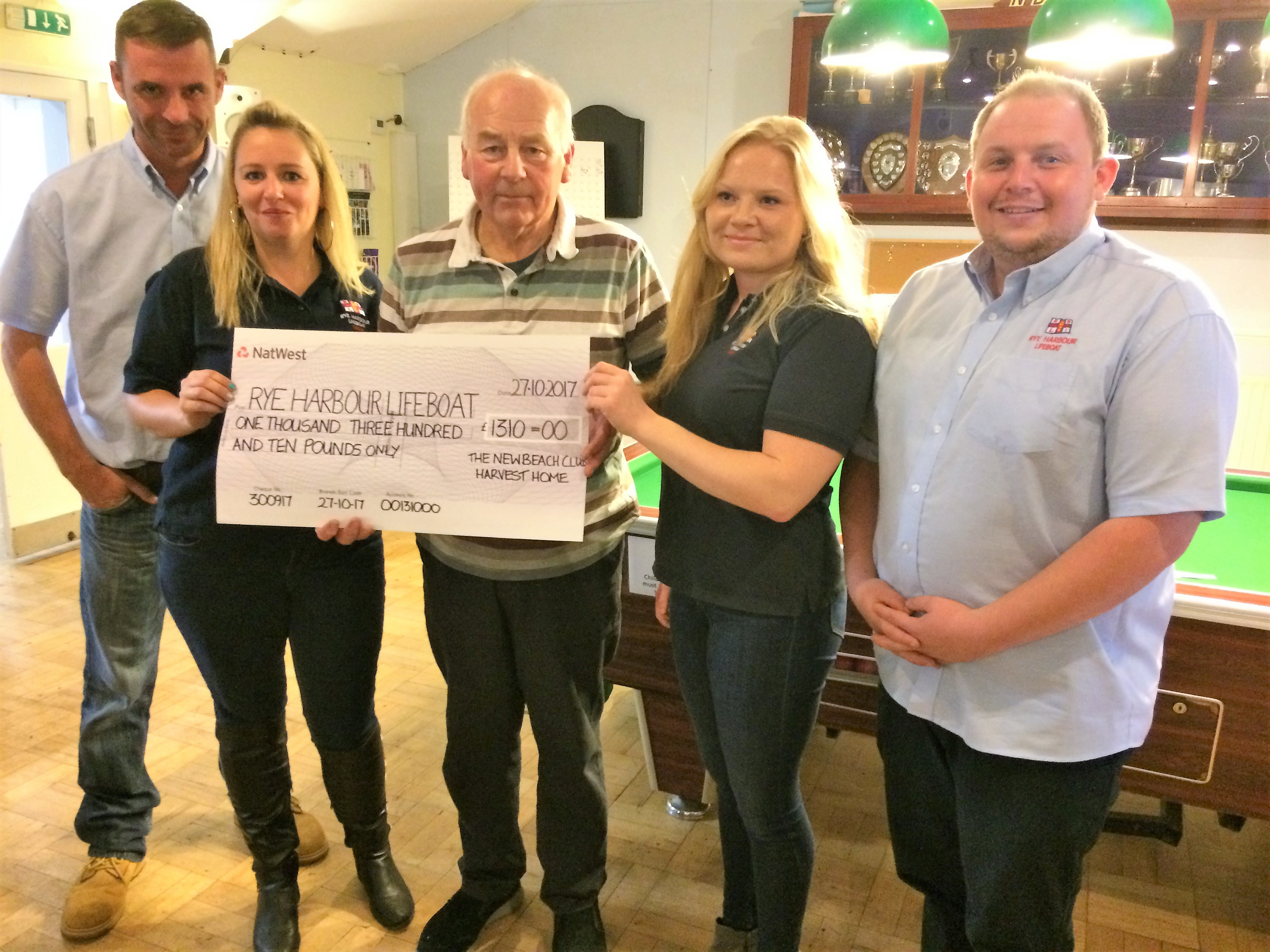 Peter Drew and members of the Rye Harbour crew with their cheque. From left to right Tony Peters, Natalie Arter, Alissia Matthews and Joe Brown