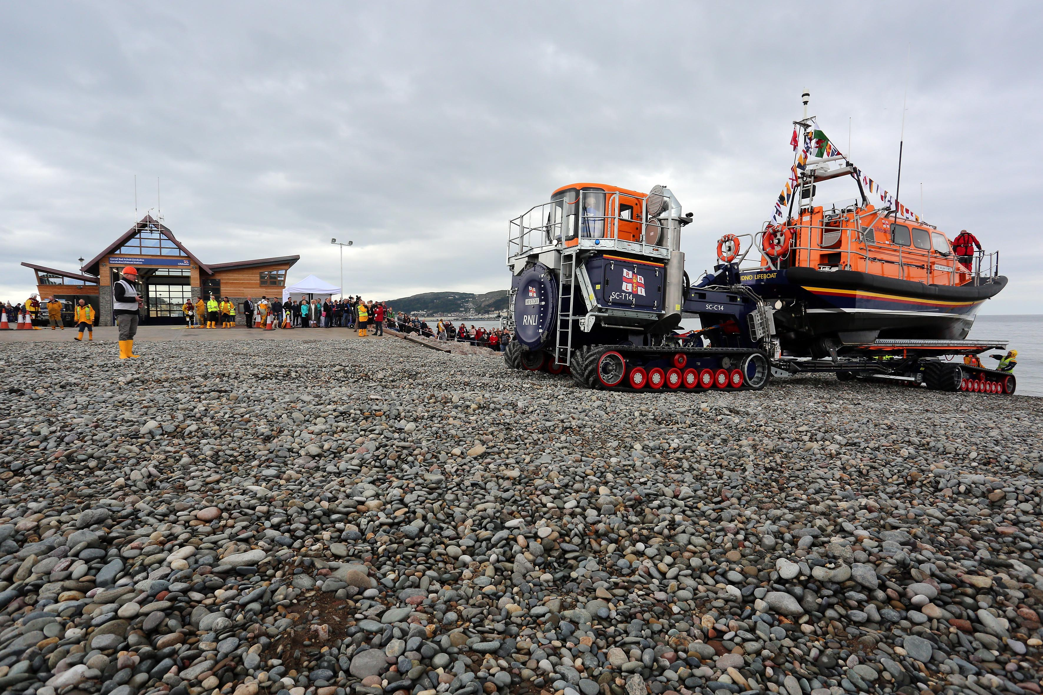 Llandudno's Shannon class lifeboat and launch and recovery kit in front of the station's new boathouse at Craig-y-Don