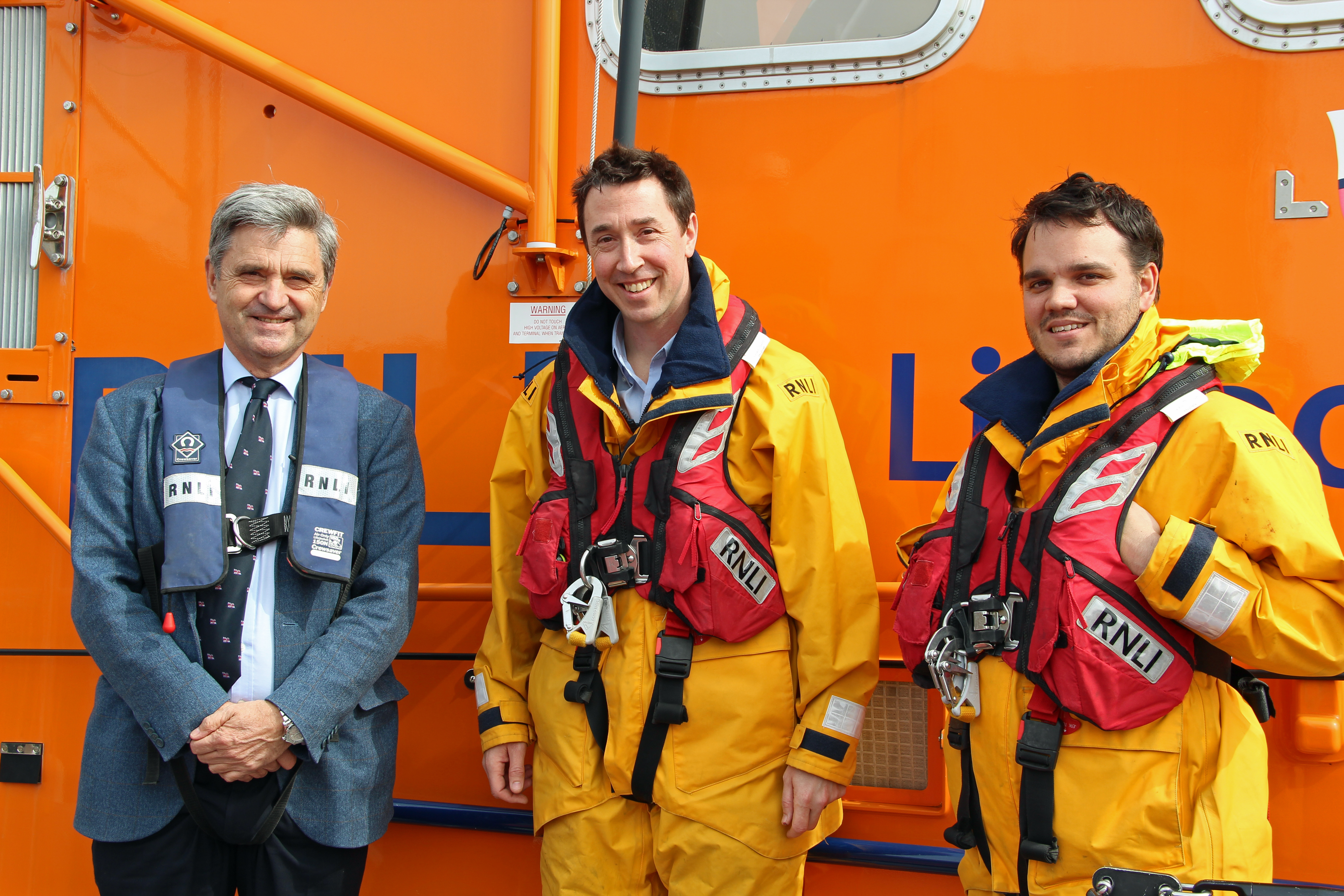 Paul Boissier (RNLI Chief Executive) meets RNLI Jersey crew members (l to r) James Hope and Gibby Gordon