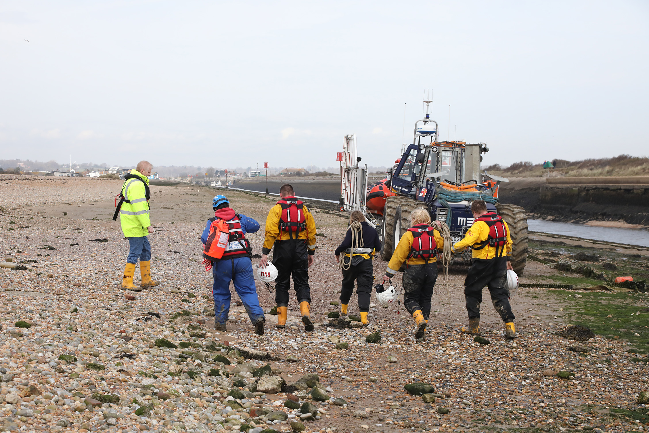 members of the RNLI volunteer crew returning to the trailer in preparation of returning to the staion