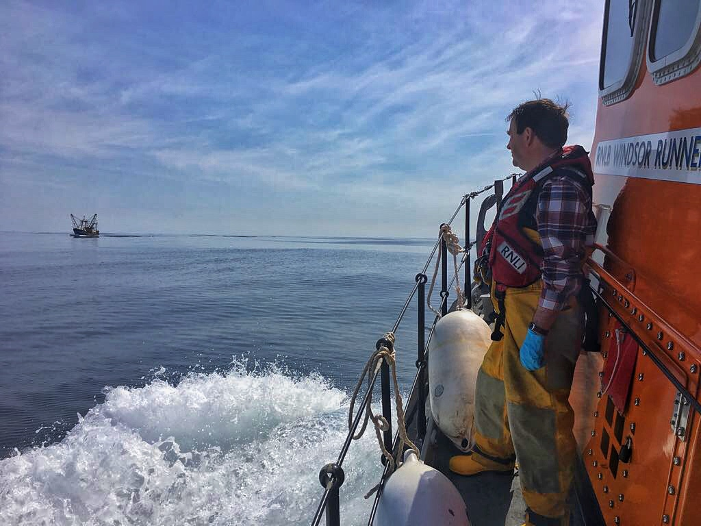 Lifeboat approaching the fishing vessel under watchful eye of Dunmore East lifeboat crew