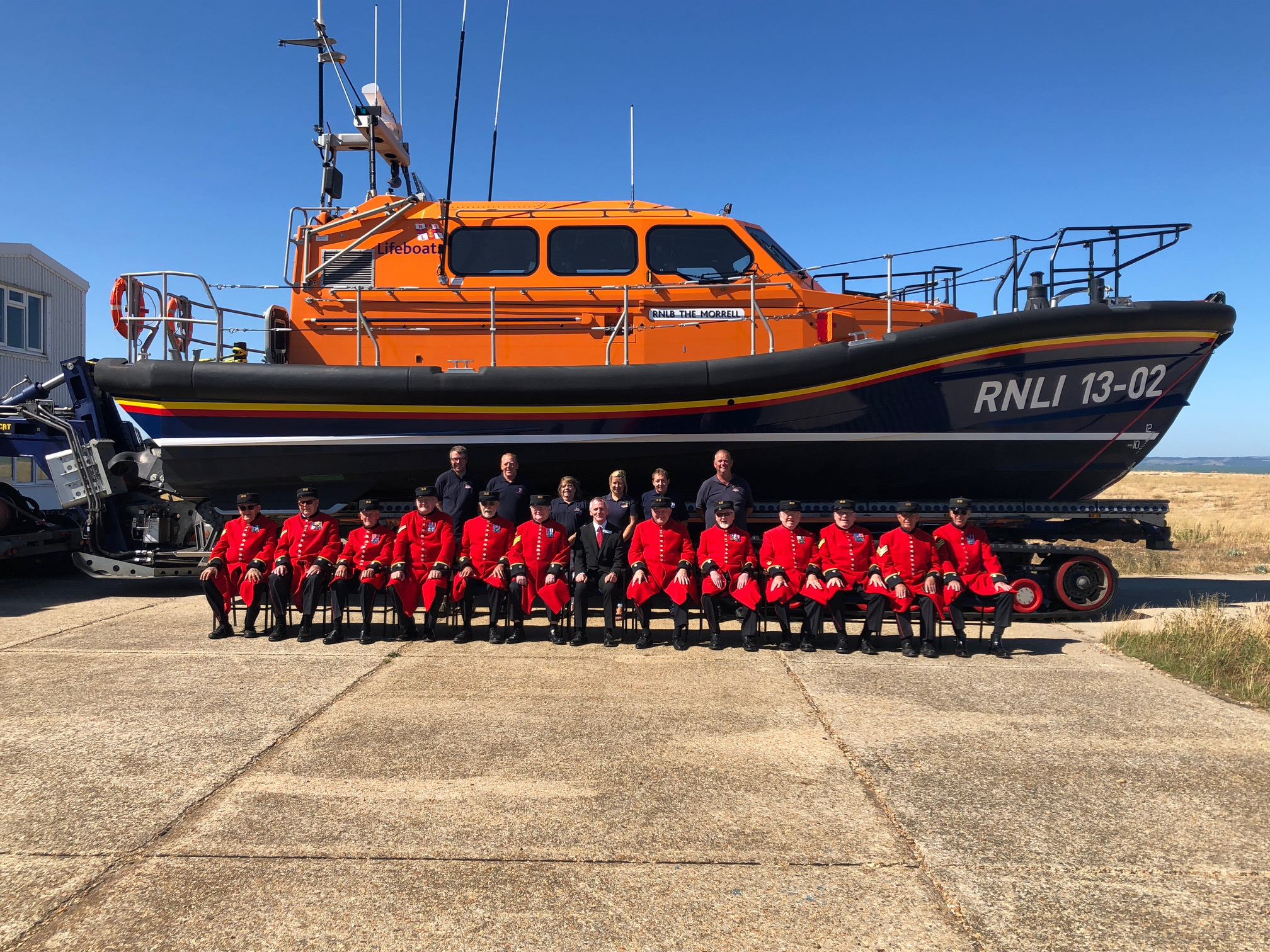 Dungeness station volunteers with the Chelsea pensioners in front the Dungeness Shannon class lifeboat 13-02 'The Morrell'