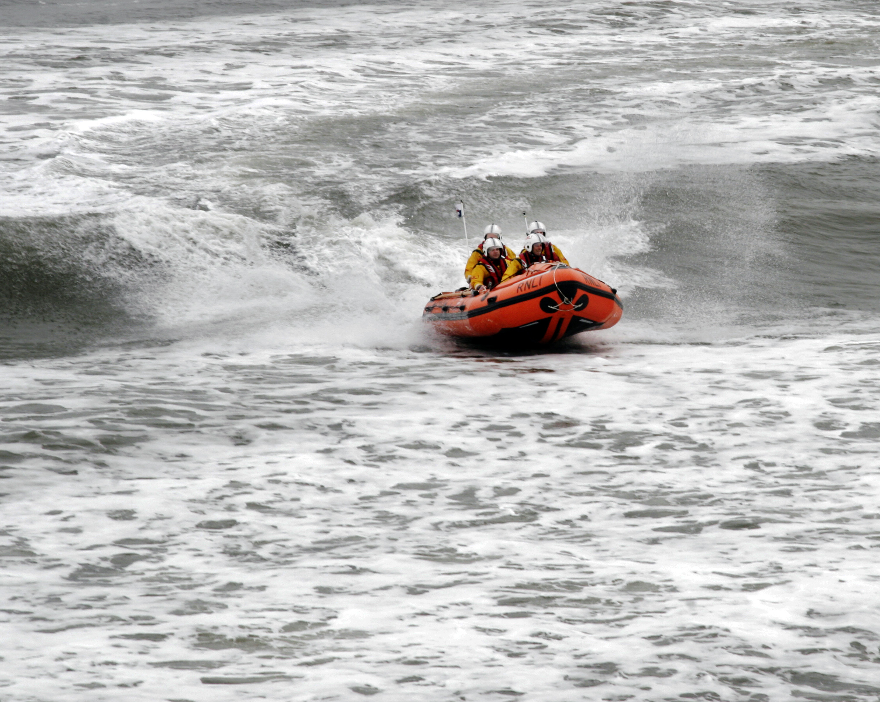 Inshore Lifeboat launching from Cromer beach.