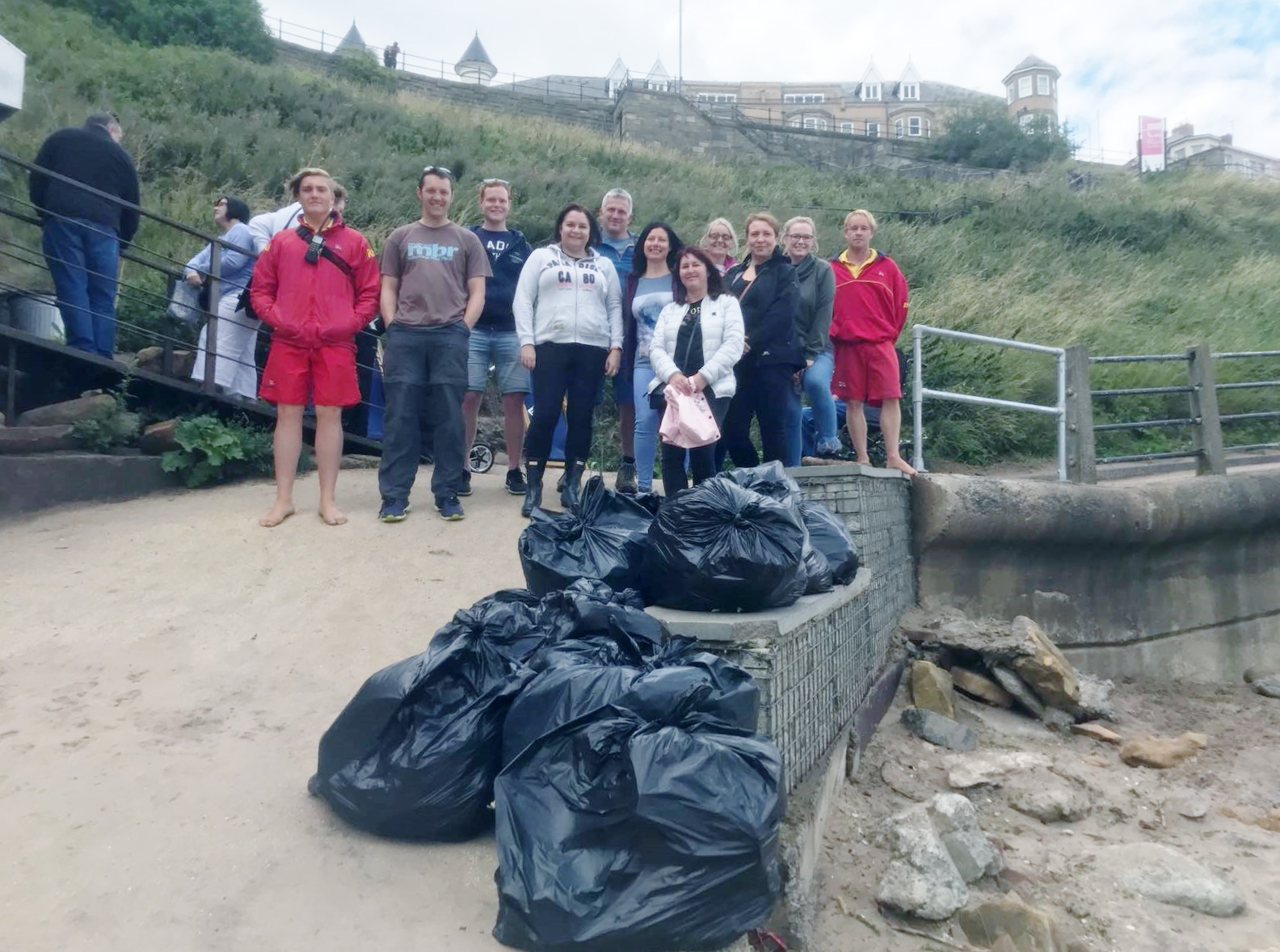 RNLI Lifeguards and North P & I team work together to clean King Edward's Bay Beach