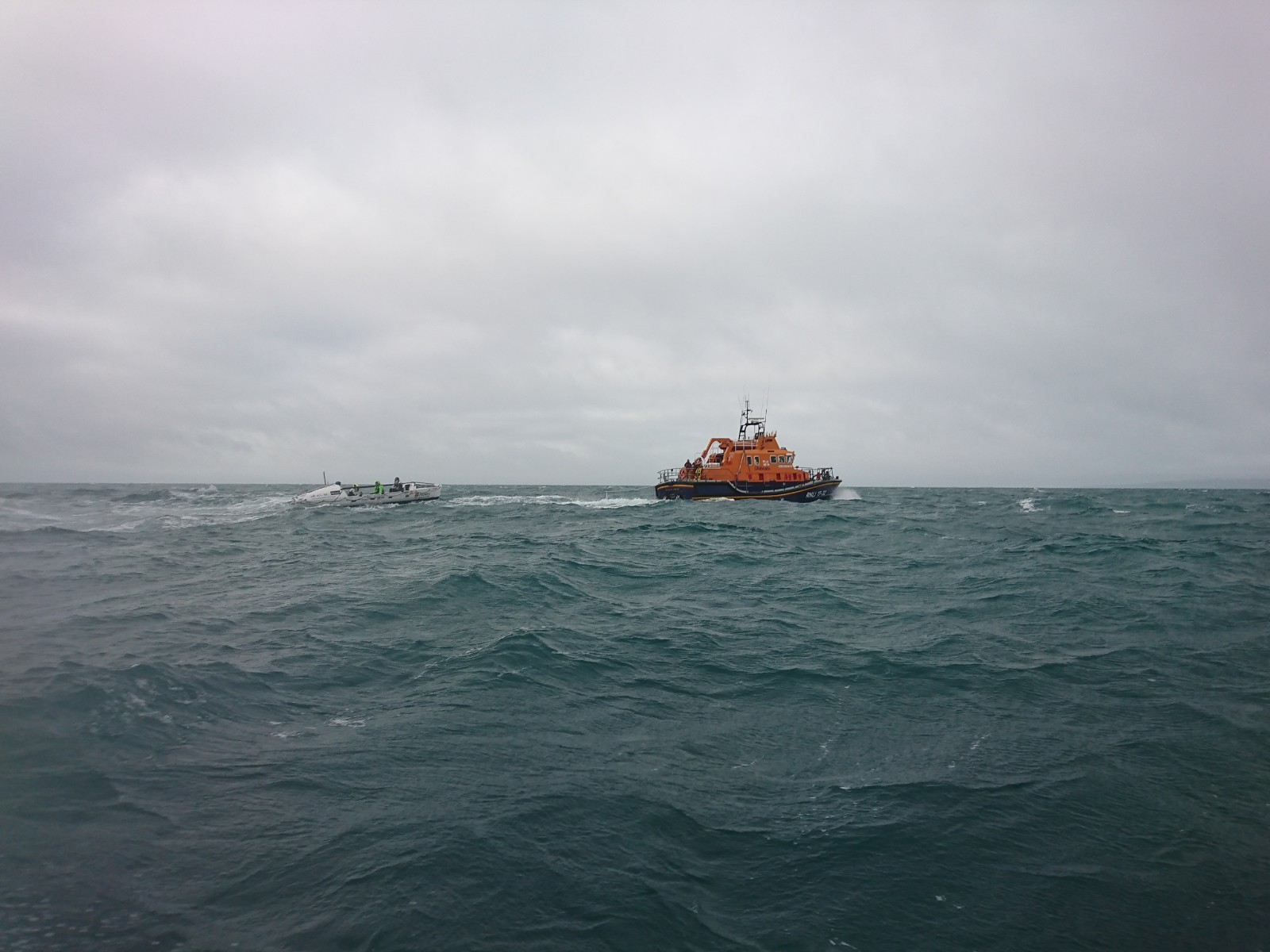 Weymouth ALB towing rowing boat