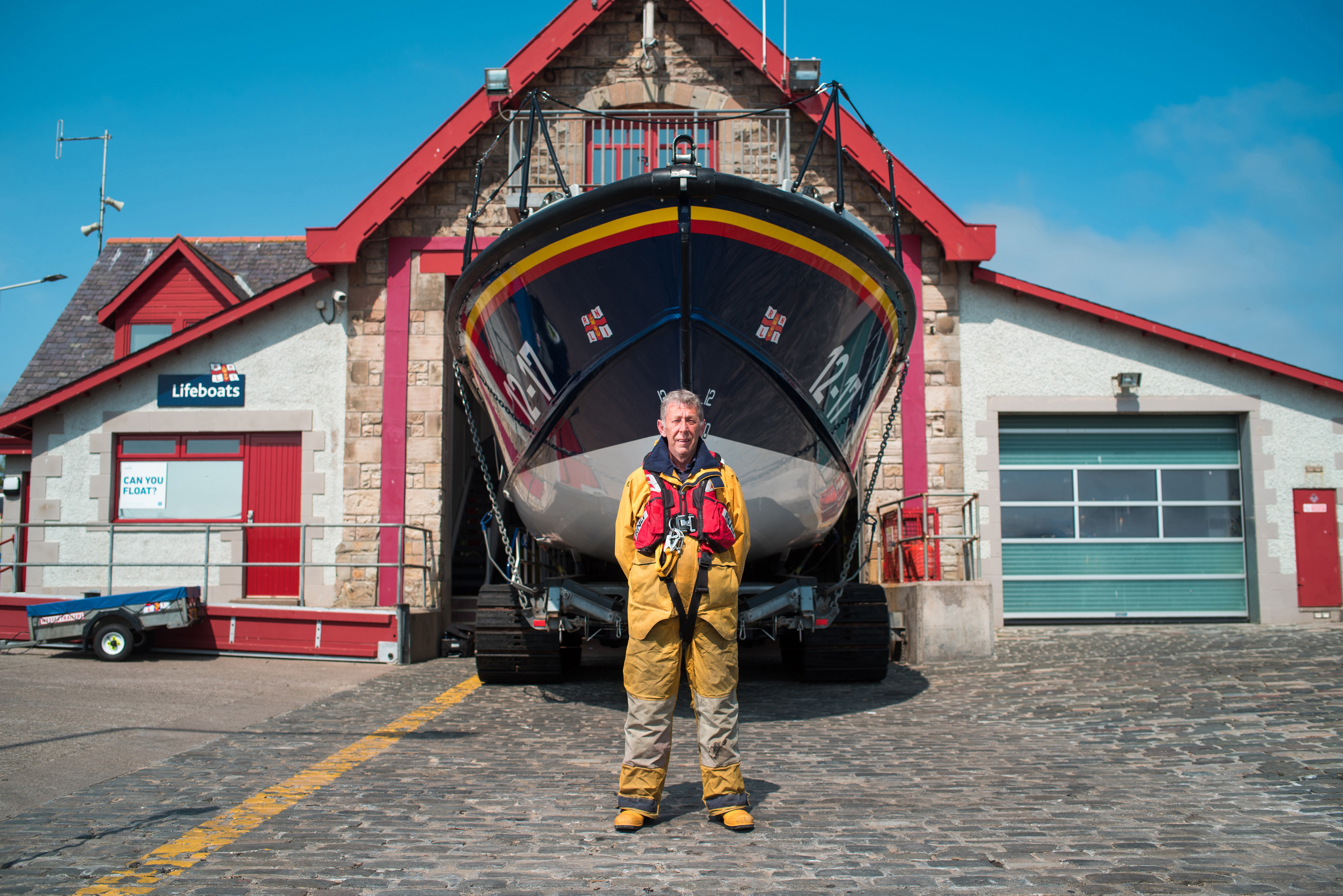 Tam Fyall standing in front of Anstruther all-weather lifeboat.