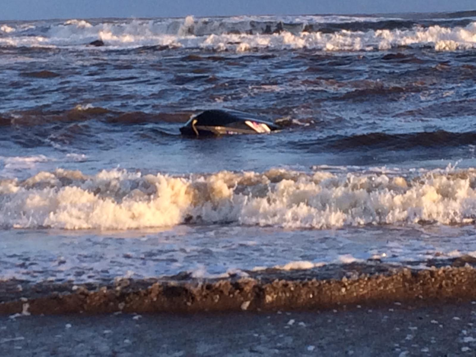 Upturned Jet Ski in Stonehaven Bay