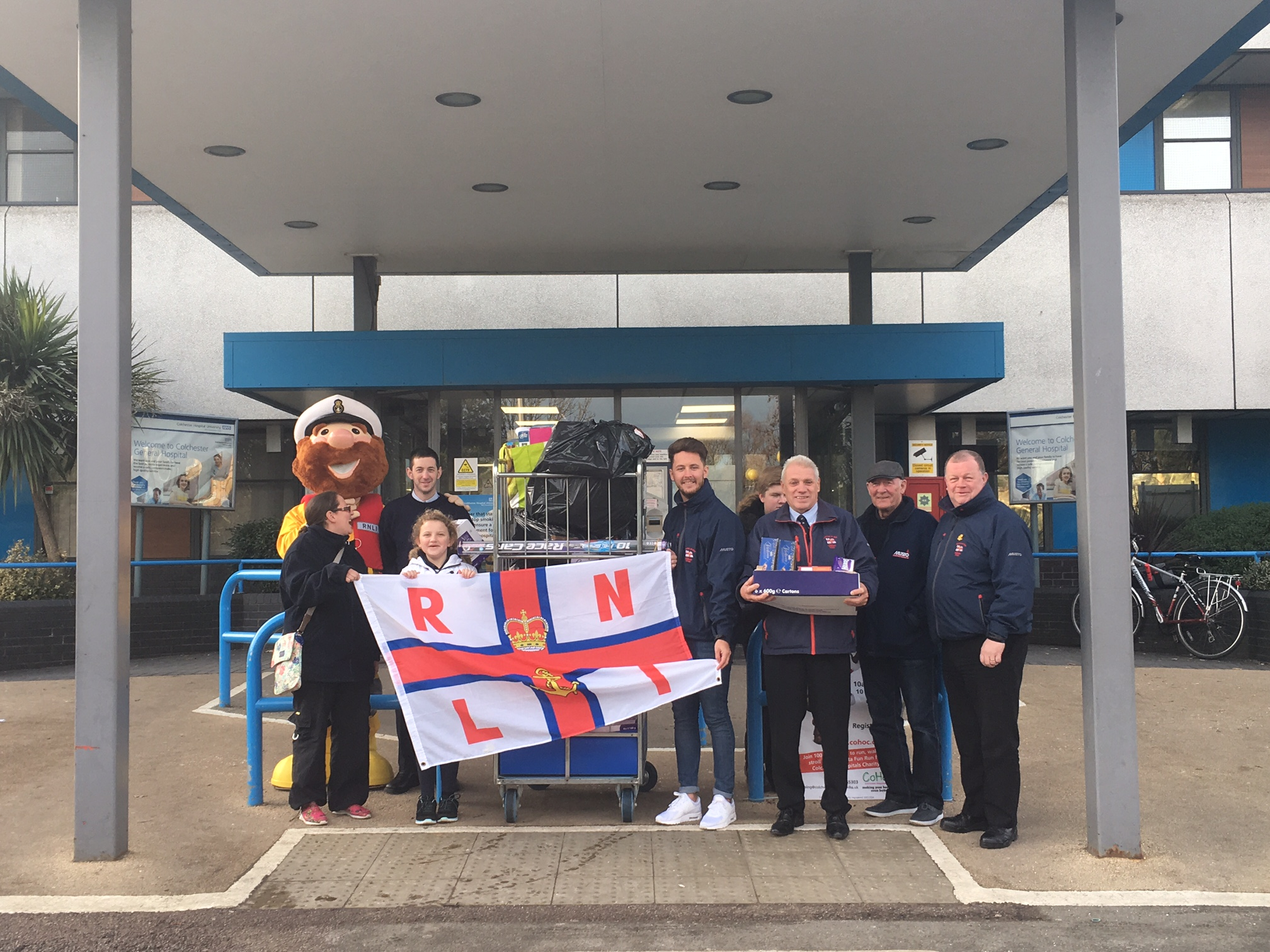 Crew standing outside Colchester hospital with donations for the children's ward