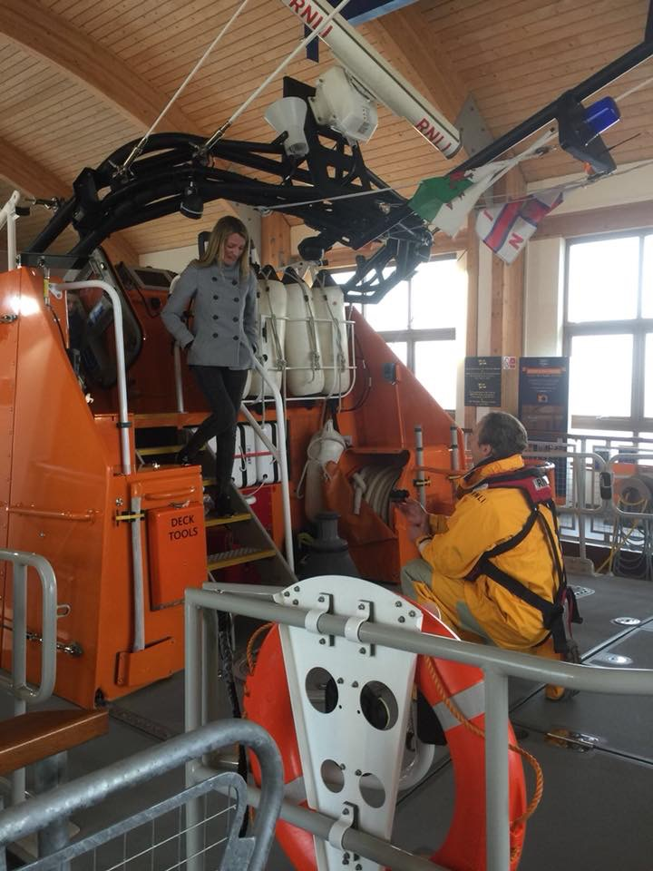 On the deck of the Tamar lifeboat on blended kneeboarding as Donna Dec ends onto the deck down the stairway.